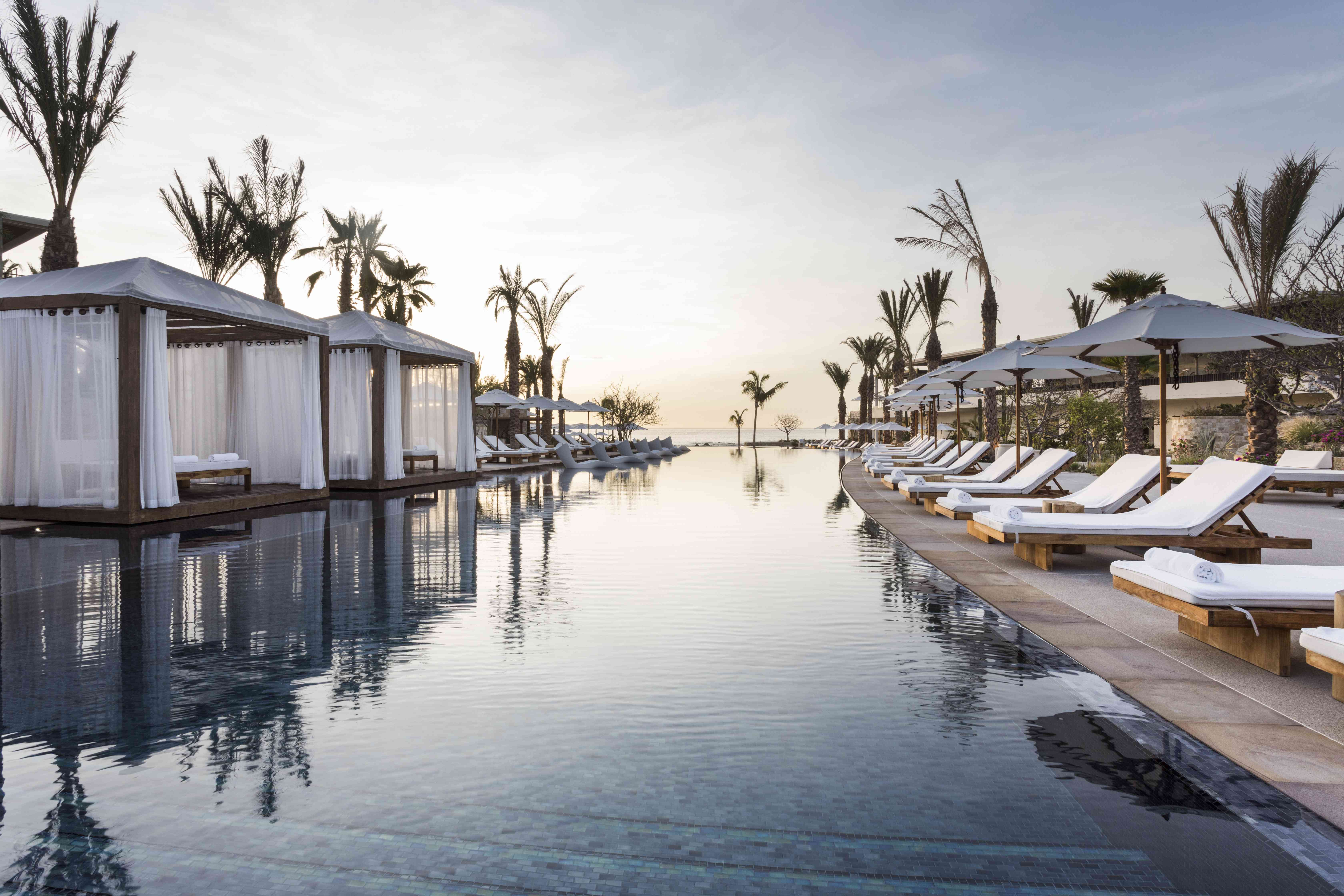 Poolside cabanas and lounge chairs at Chileno Bay Resort & Residences