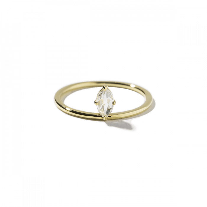 Marquise diamond engagement ring with yellow gold band on a white background.