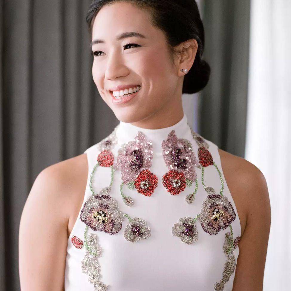 Smiling bridal close up with embellished dress
