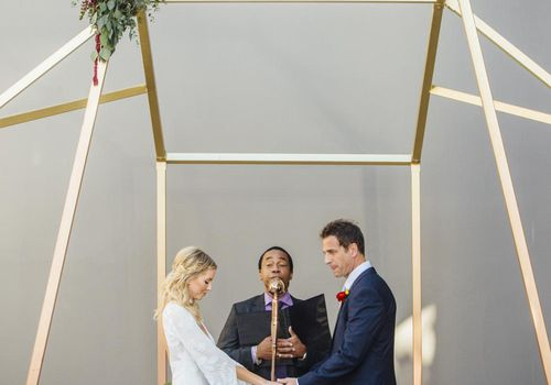 Bride and groom at modern altar