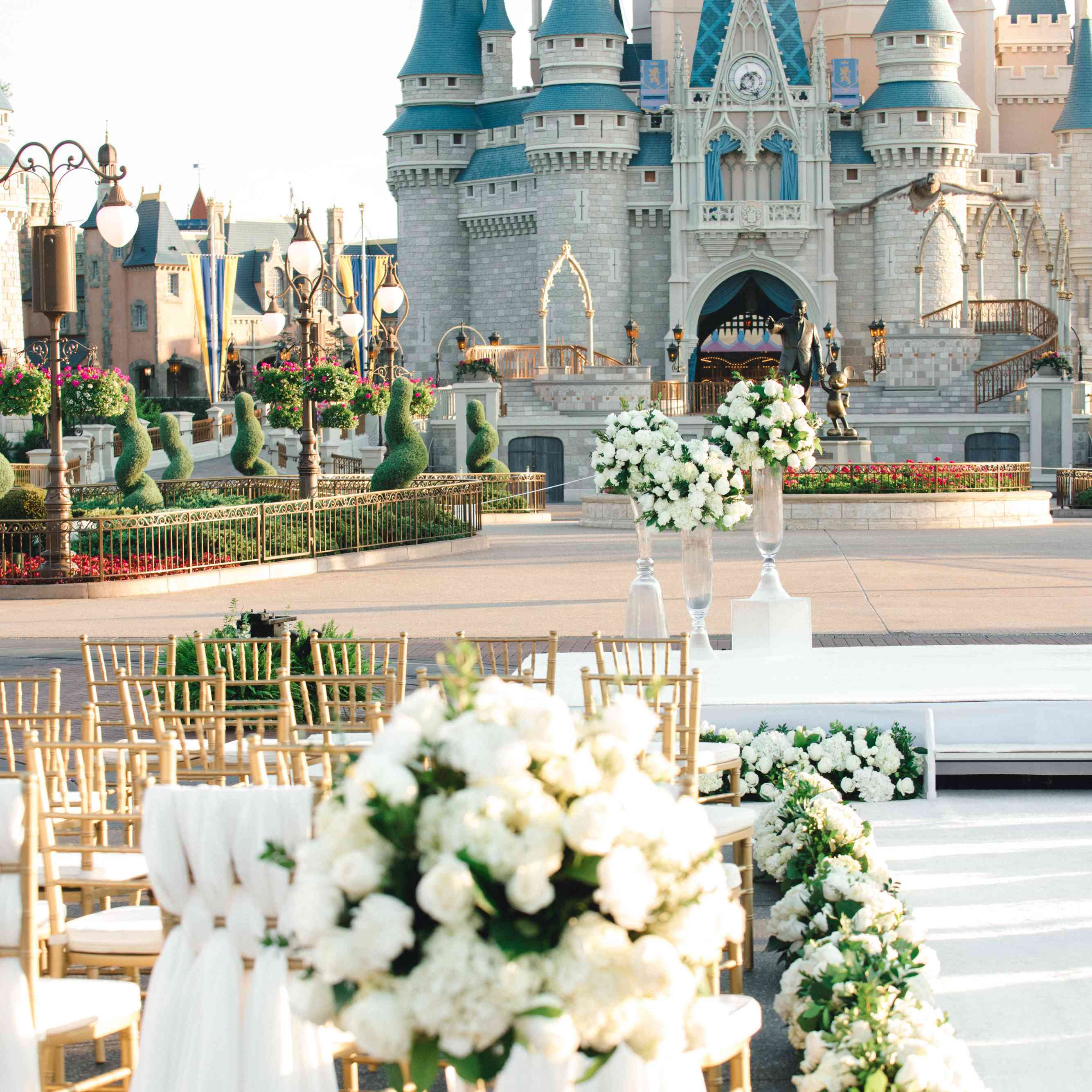 Chairs and flowers outside Cinderella's Castle.