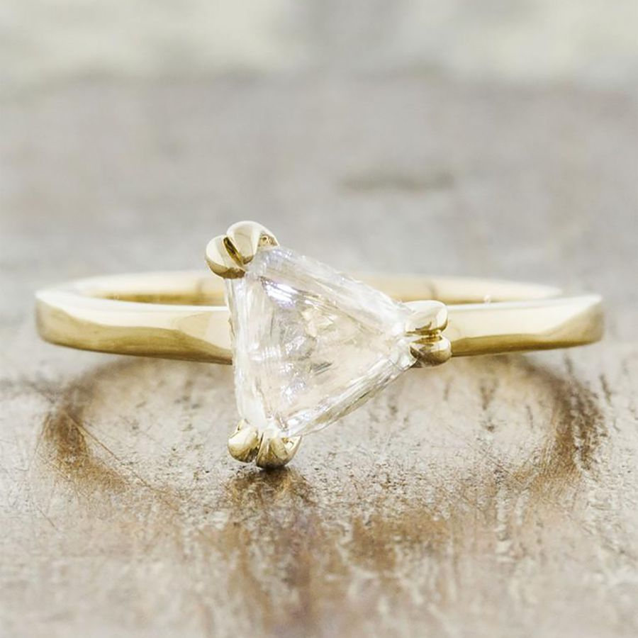 Uncut rough diamond maccle in a double prong setting in yellow gold