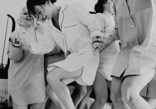 <p>Bridesmaids jumping on bed</p>