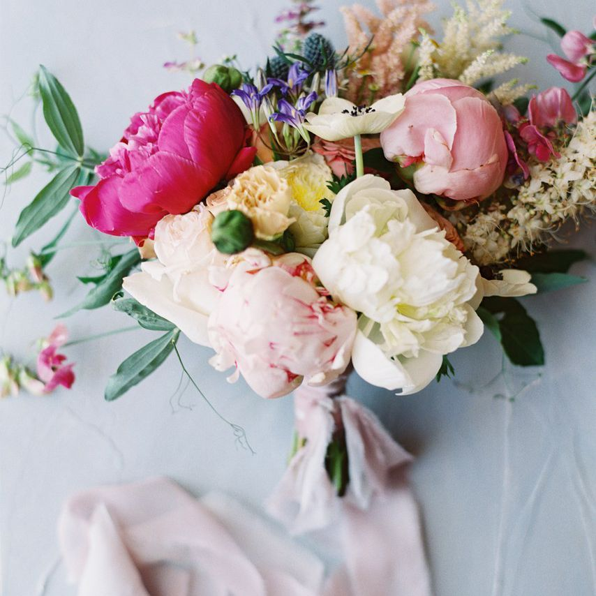 Pink, purple, cream, and yellow bouquet of wildflowers and peonies