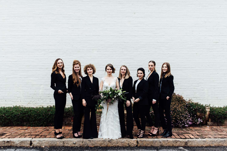 Bridesmaids wearing all-black menswear.