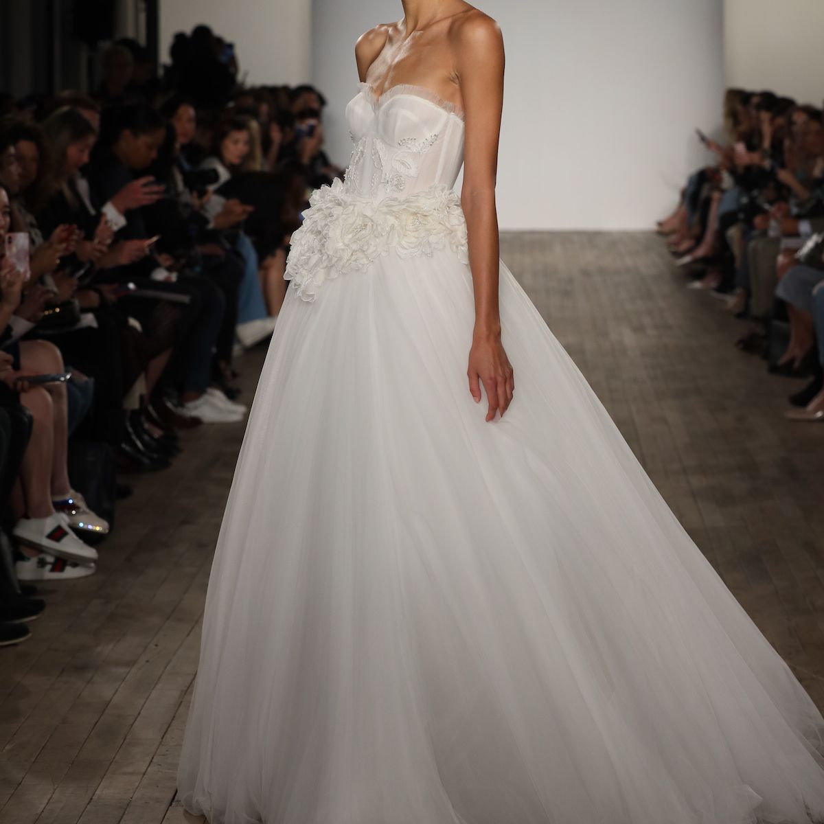 Model in strapless corseted wedding ball gown