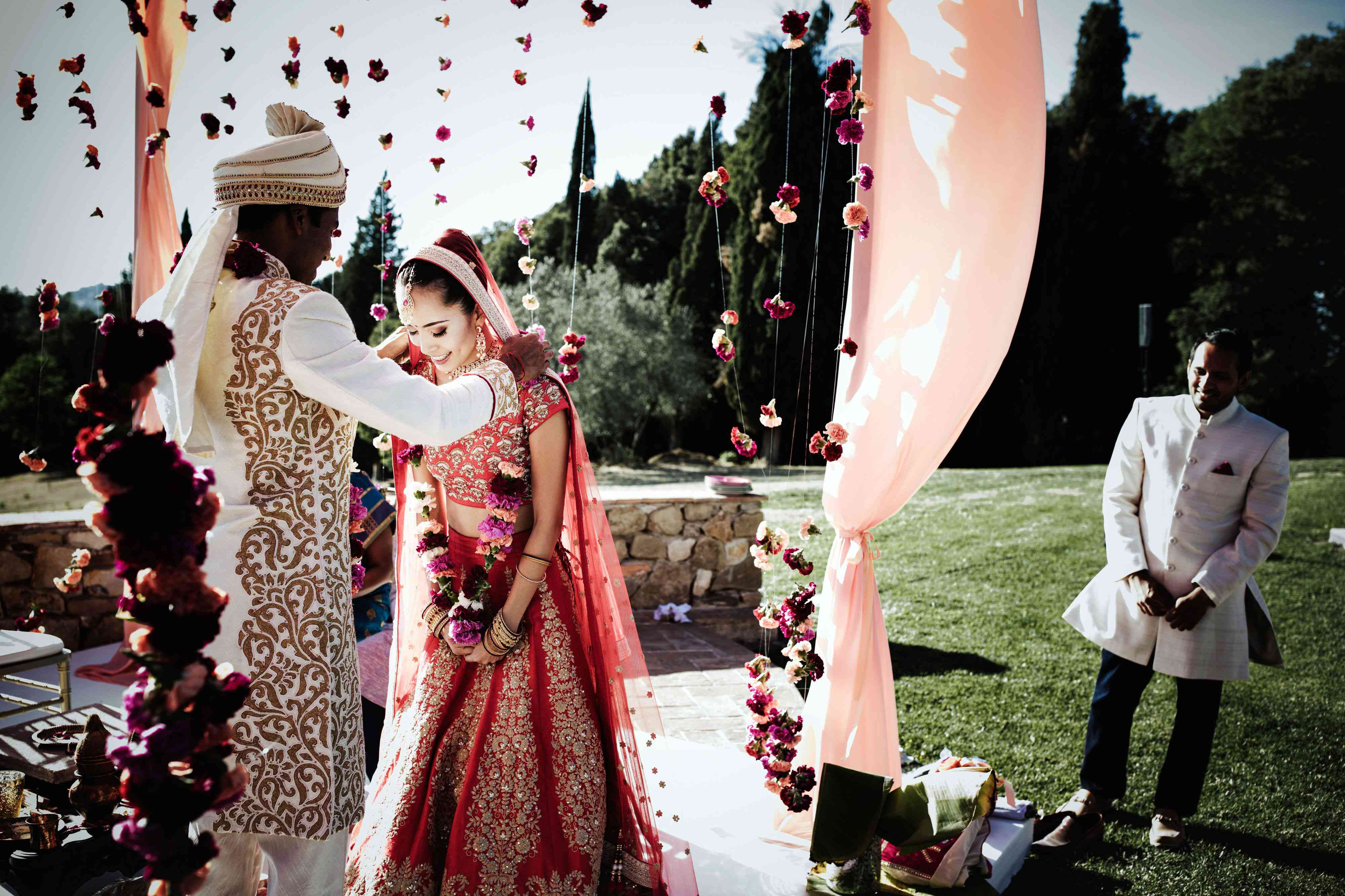 bride and groom exchanging floral garland