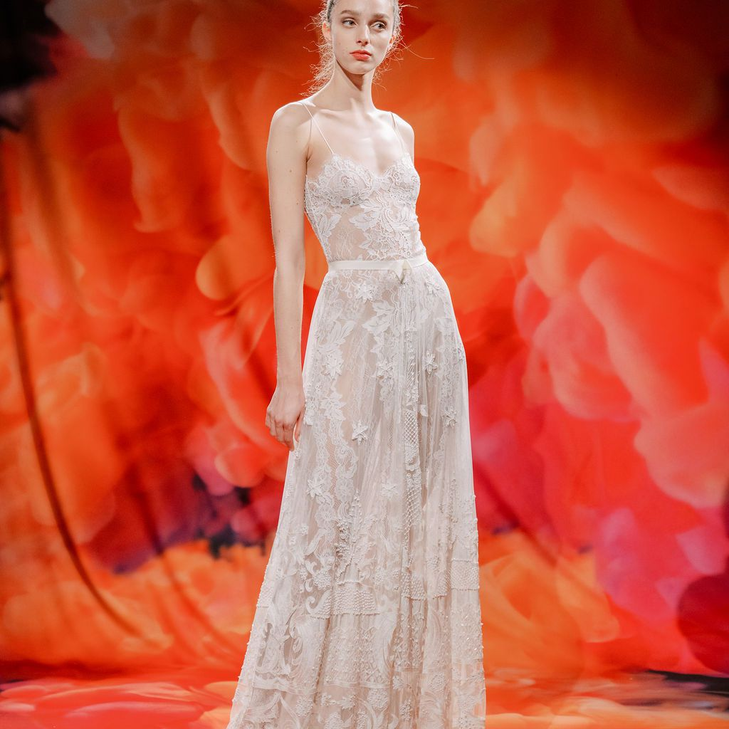 Model in sheer A-line lace gown with thin straps
