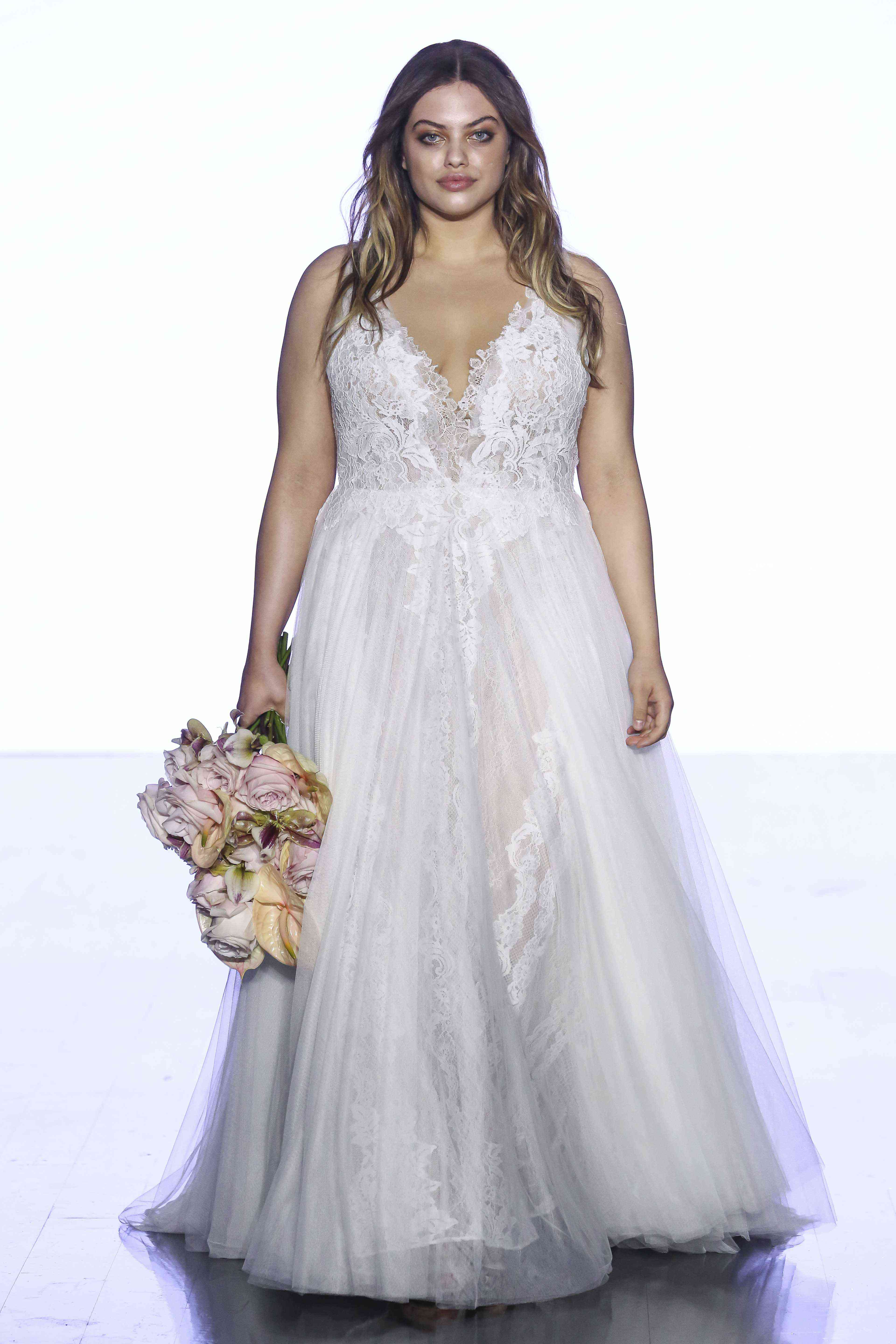 Model in V-neck lace and tulle A-line gown