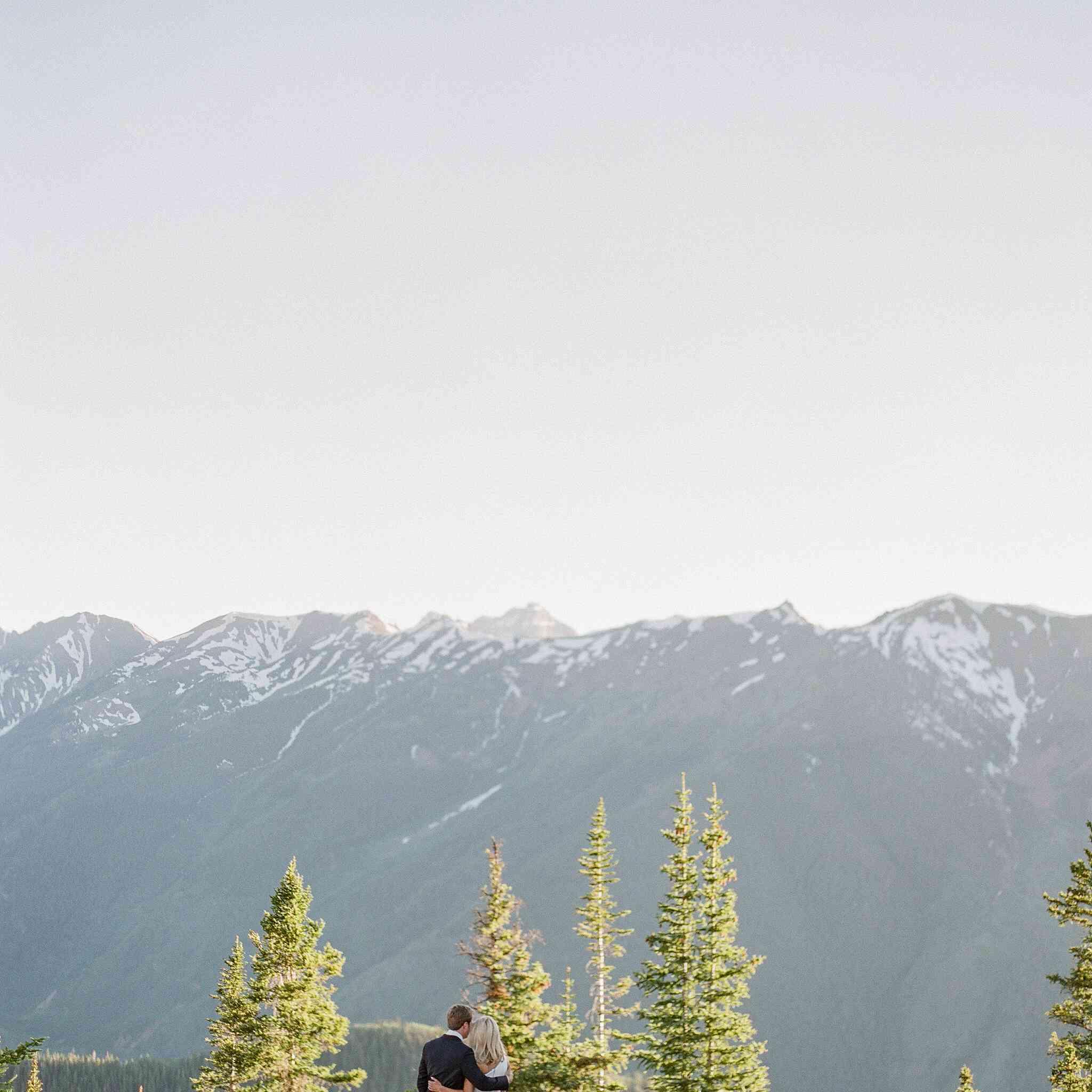 Bride and groom overlooking mountain