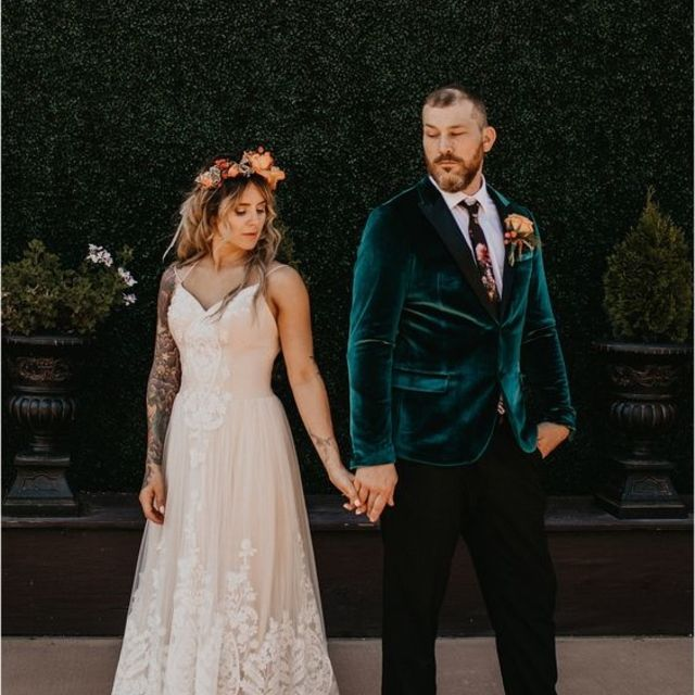 Tattooed bride wearing an intricate lace gown