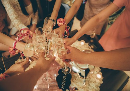 Women toasting with champagne at bridal shower