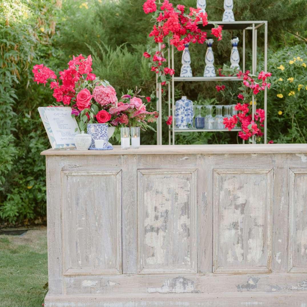 Fuchsia florals against blue porcelain vases