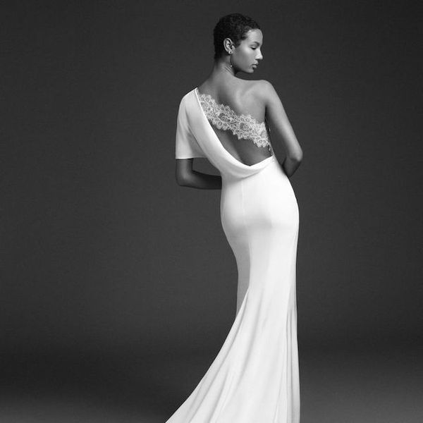 Model in fitted one-shoulder wedding gown