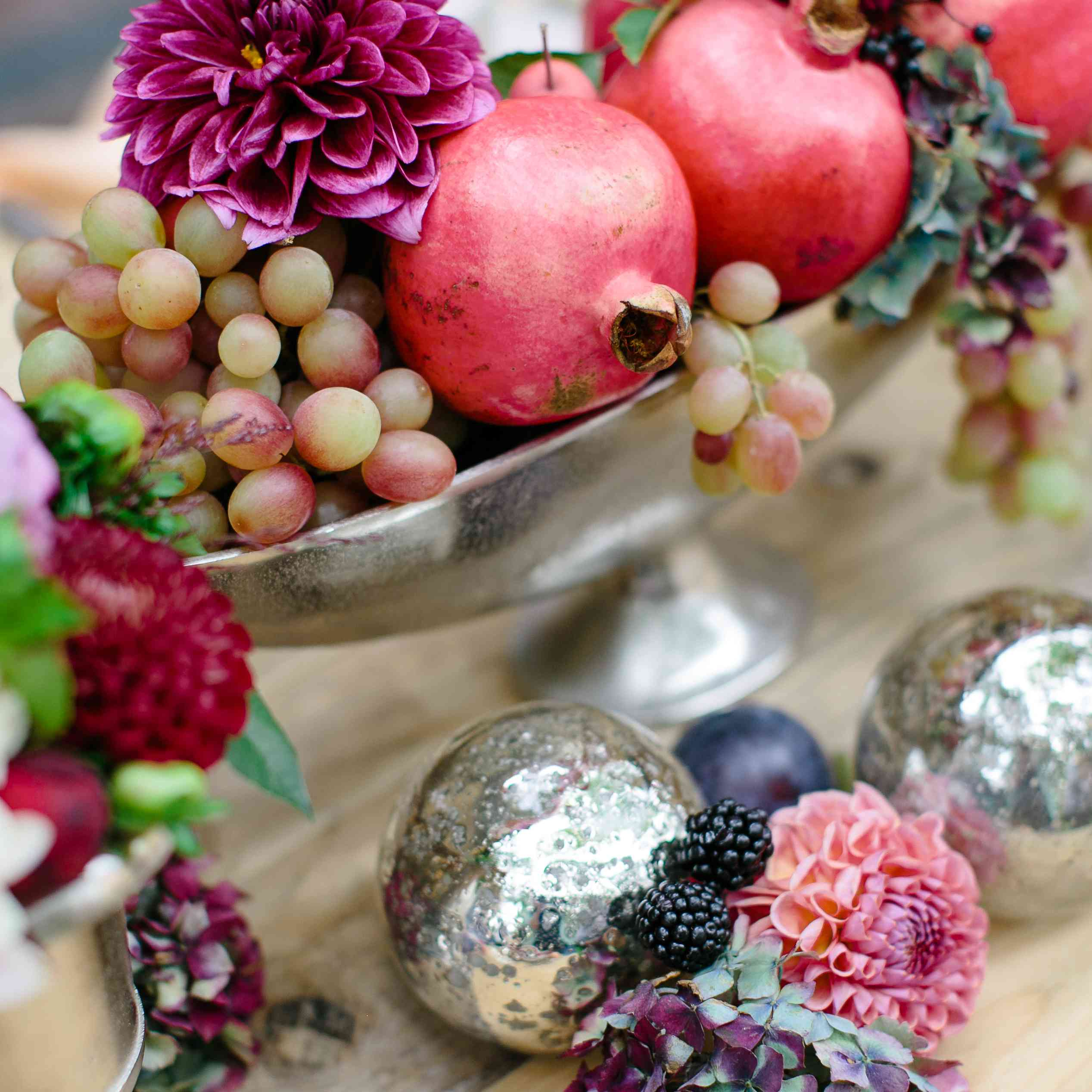 Berries and plums used in a centerpiece