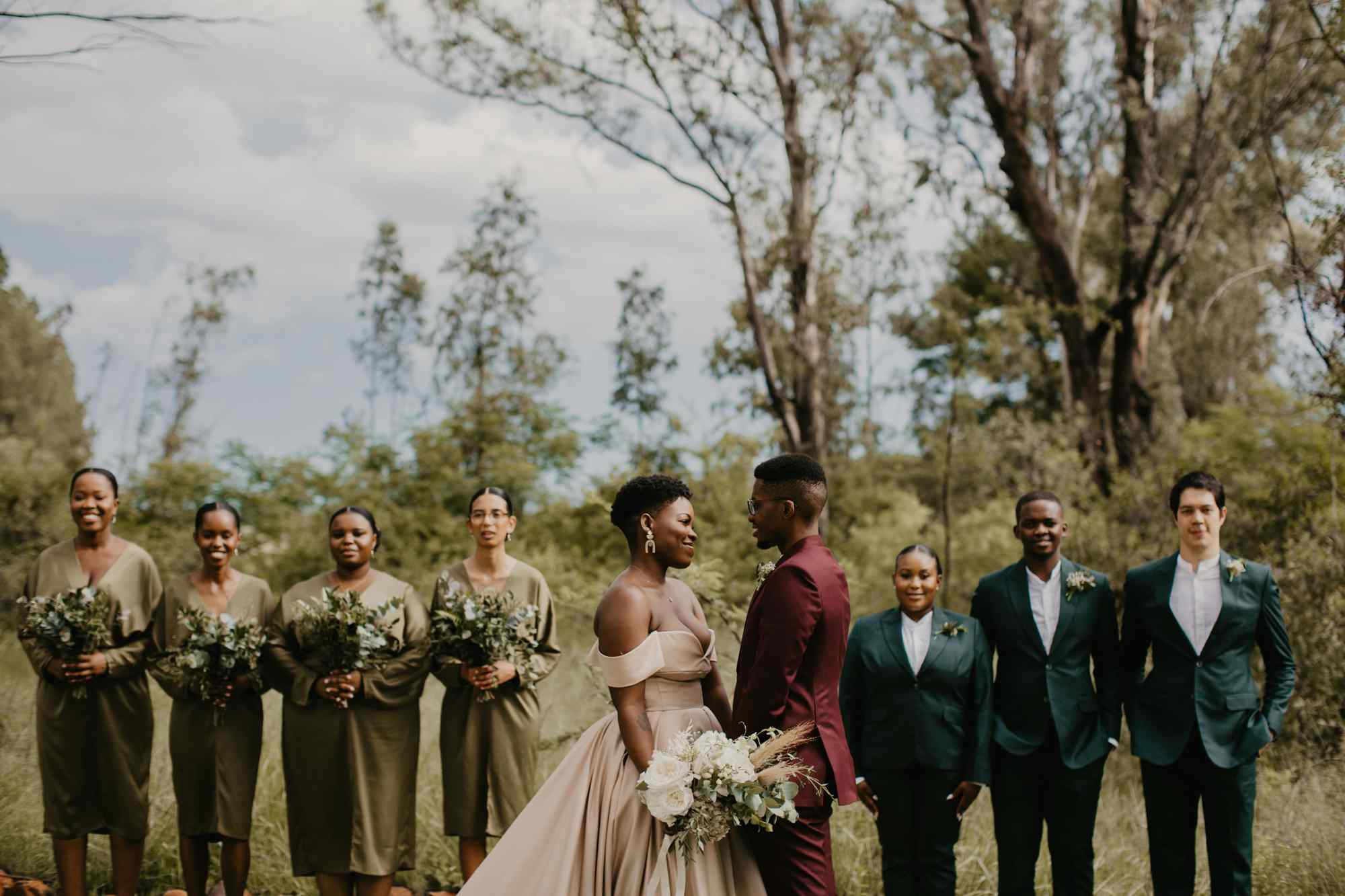 Colorful bridal party in greens and burgundy