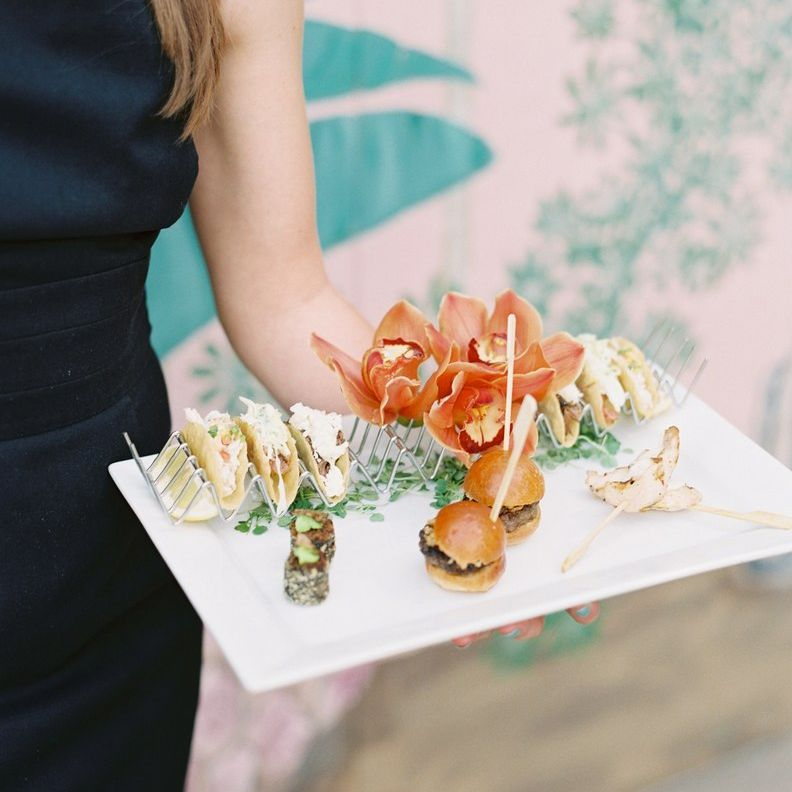 A plate of small passed appetizers at a wedding