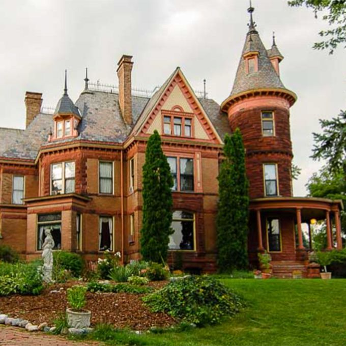 """The opulent 1895 mansion makes for a stunning wedding venue with sweeping views of downtown Kalamazoo and acres of spectacular gardens and grounds. And did we mention a legion of ghosts? The bed and breakfast caters to numerous dead, including original owners Frank and Mary Henderson, a little girl, and a dog. Activity has including a man's voice coming from an unplugged radio, finding a picture frame with """"Clare"""" freshly written in the dust, and electronic voice phenomena recordings of a woman's voice saying """"flowers and candy."""". Others have spotted the ghosts appearing in full period garb, and unreachable high cabinet doors being opened. But don't worry, the employees of the inn assure their guests these are friendly ghosts"""