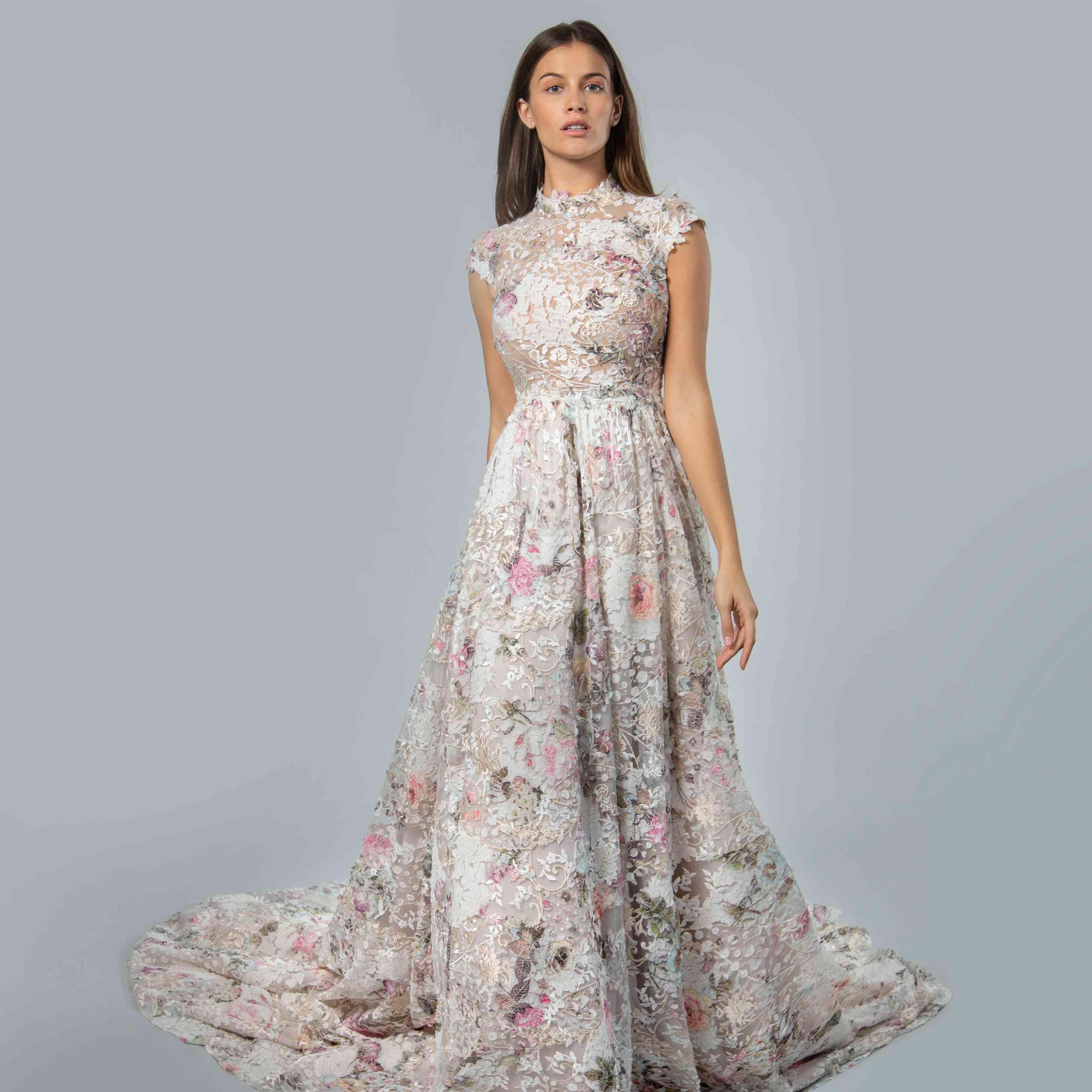 Model in mock neckline floral ball gown