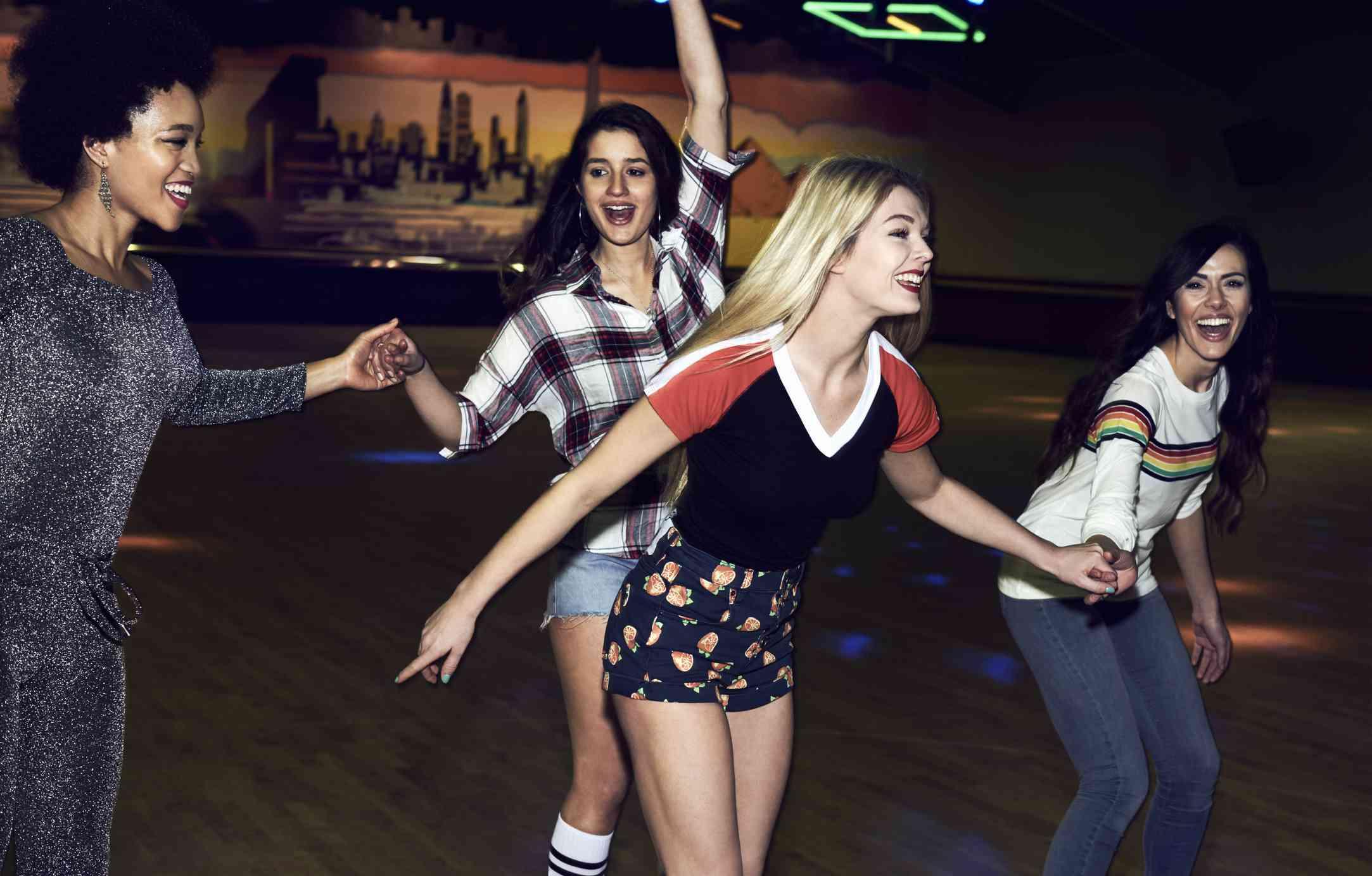 Four girlfriends roller blading