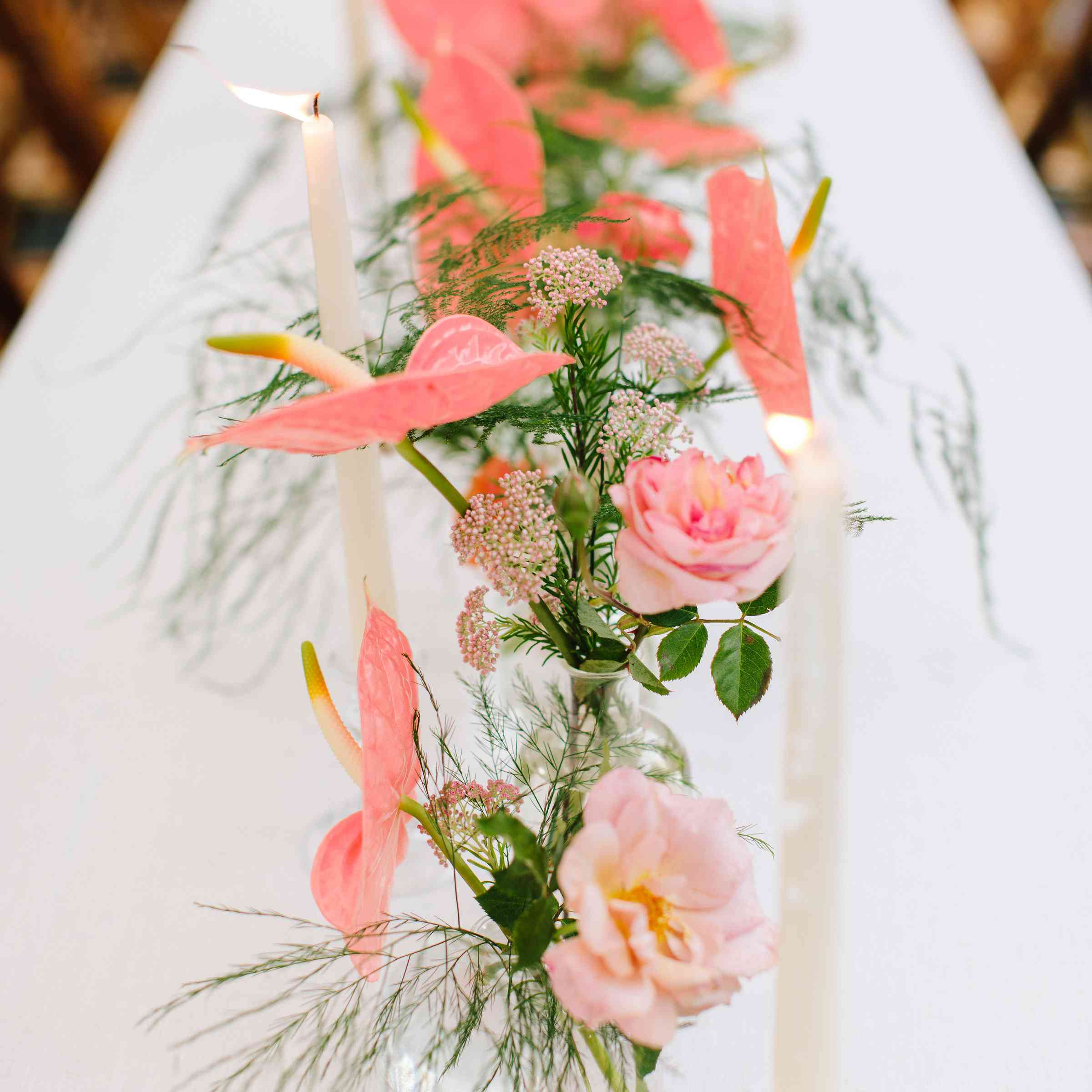 candles and pink flowers wedding reception