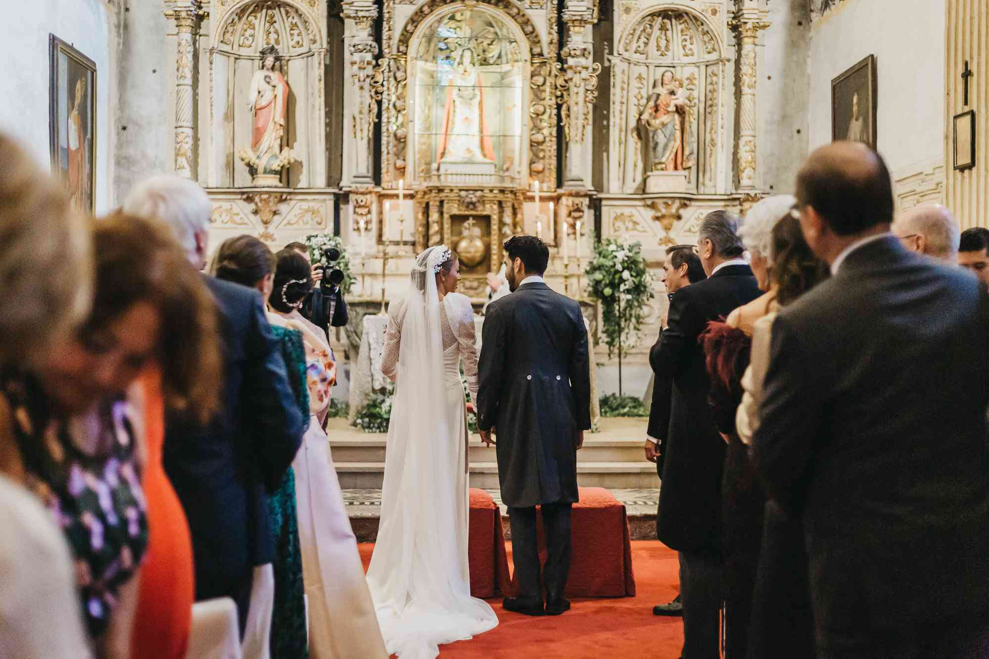 Bride and groom in church for Catholic wedding