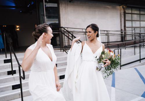two brides hi-fiving