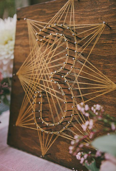 Handmade string-and-nail table numbers
