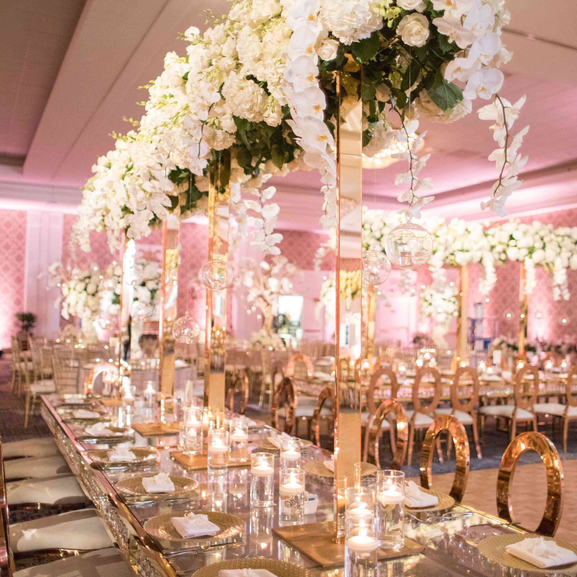 tall floral centerpieces mirrored tables