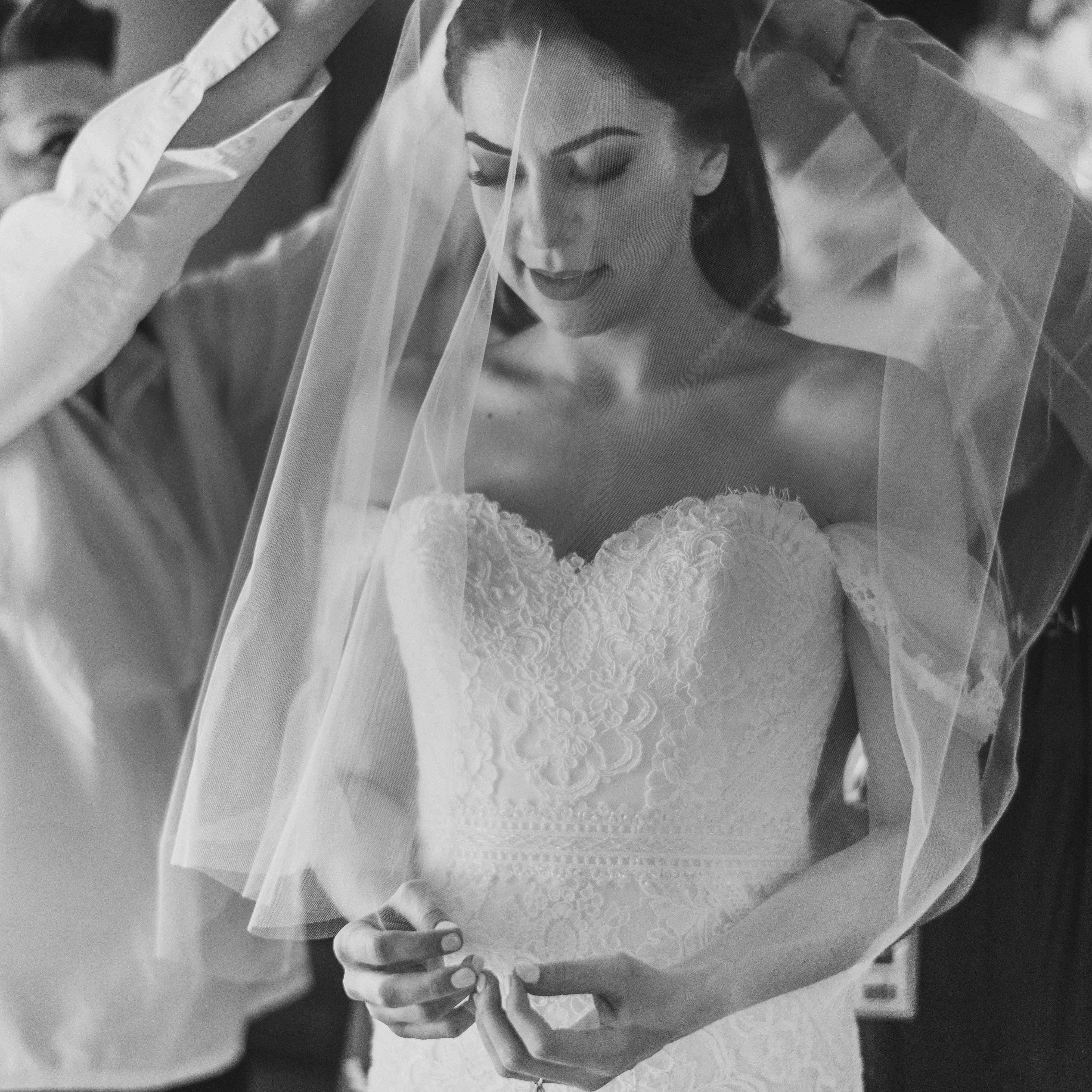 bride in veil getting ready