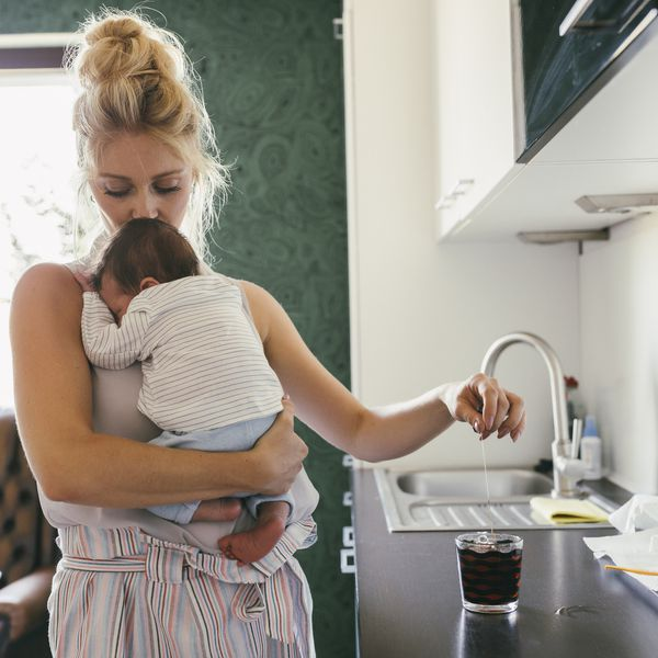 mother in kitchen with baby
