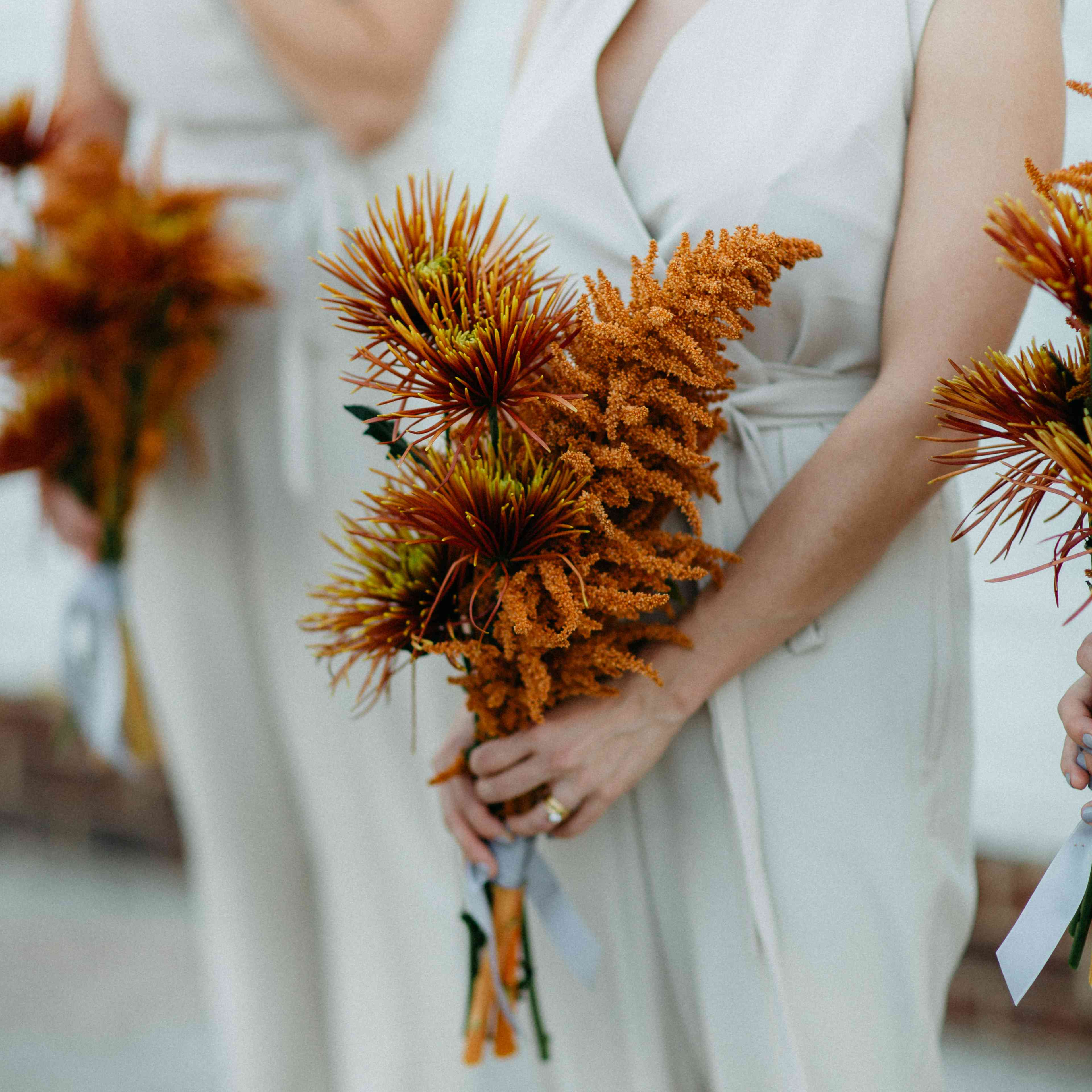 Bridesmaid bouquets consisting of mums and amaranthus
