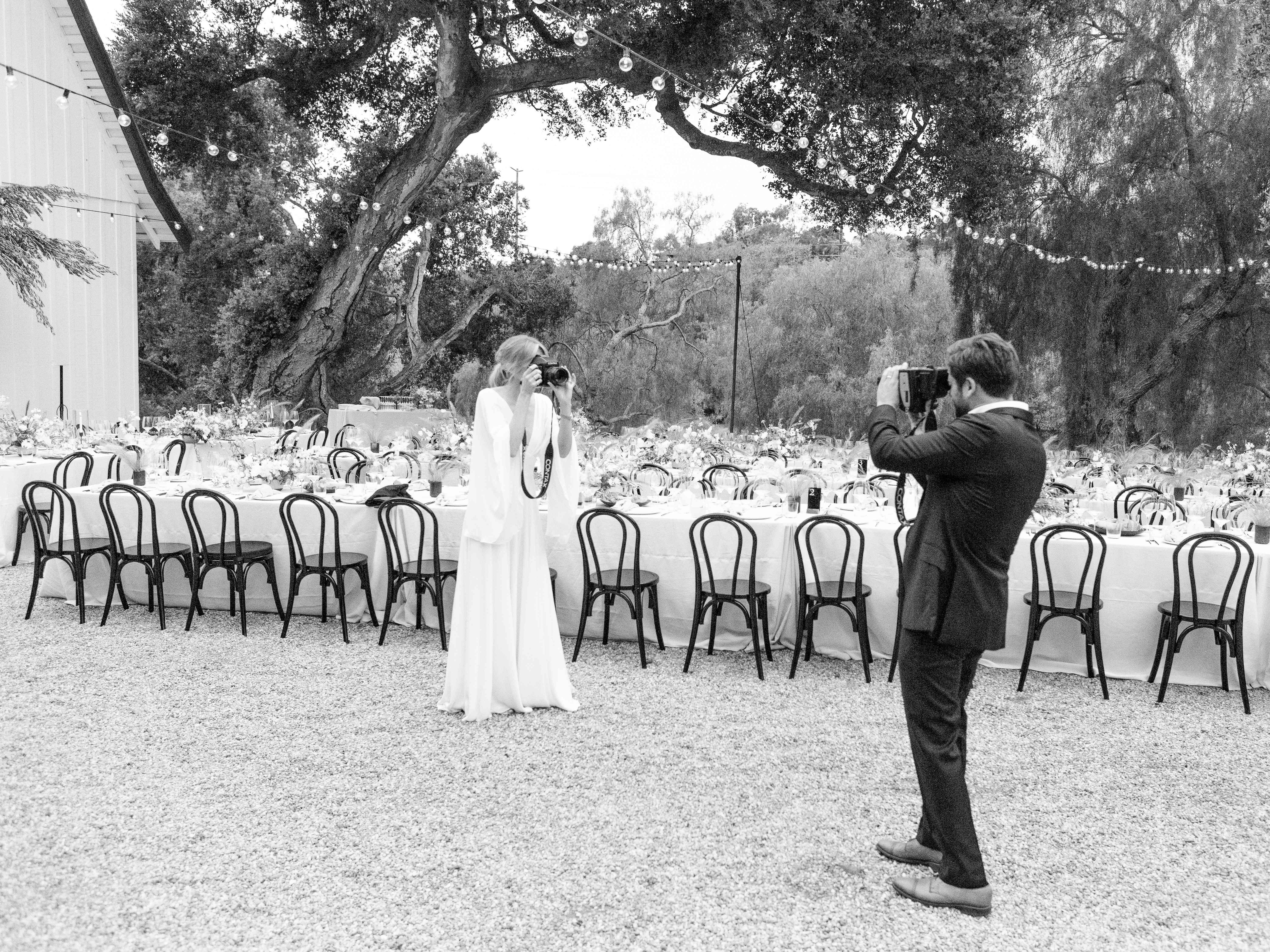 bride and groom with cameras