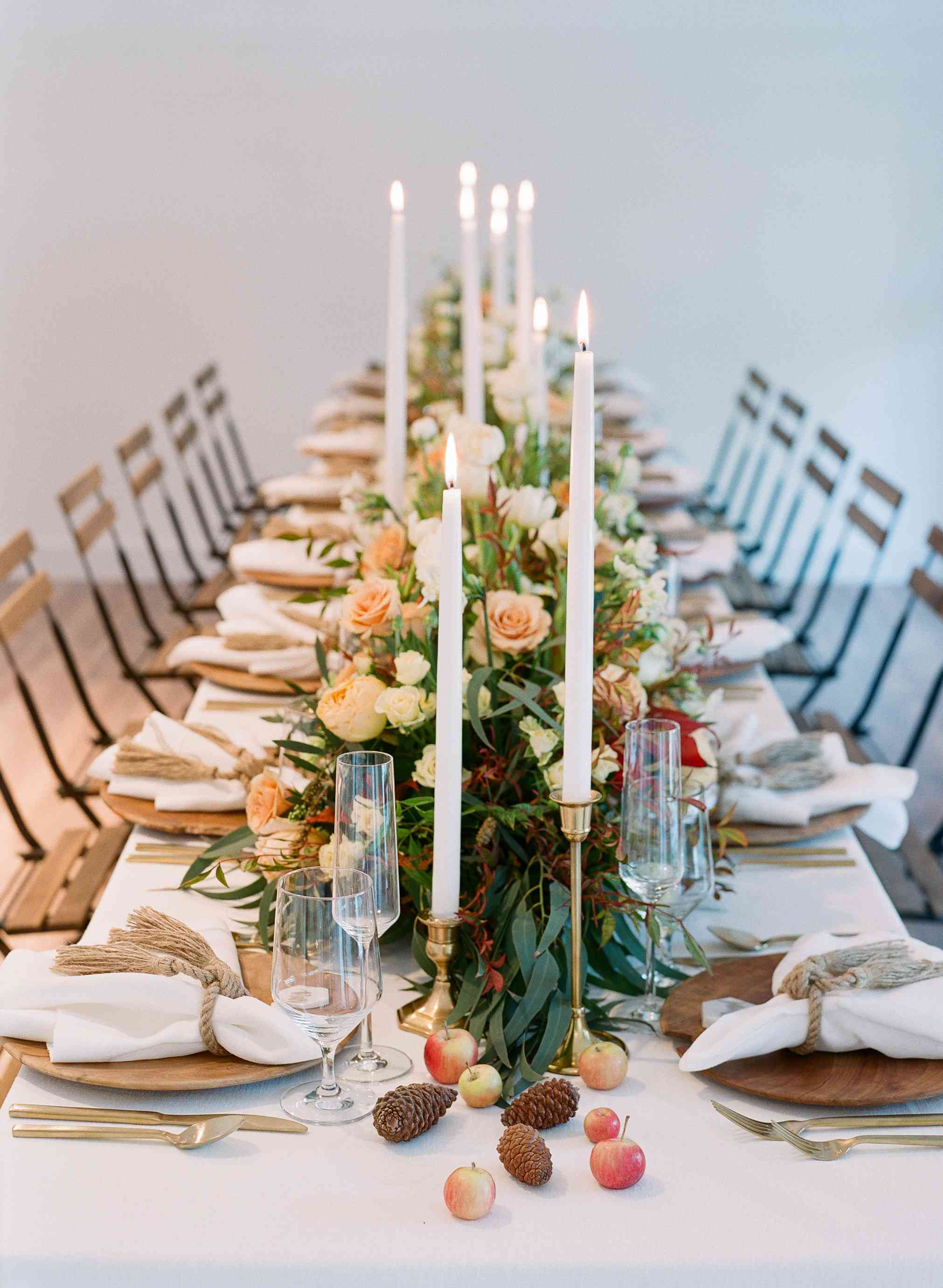 table setup with pinecones and apples