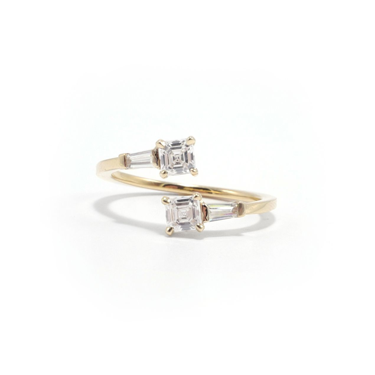 Two-stone diamond engagement ring with yellow gold band on a white background