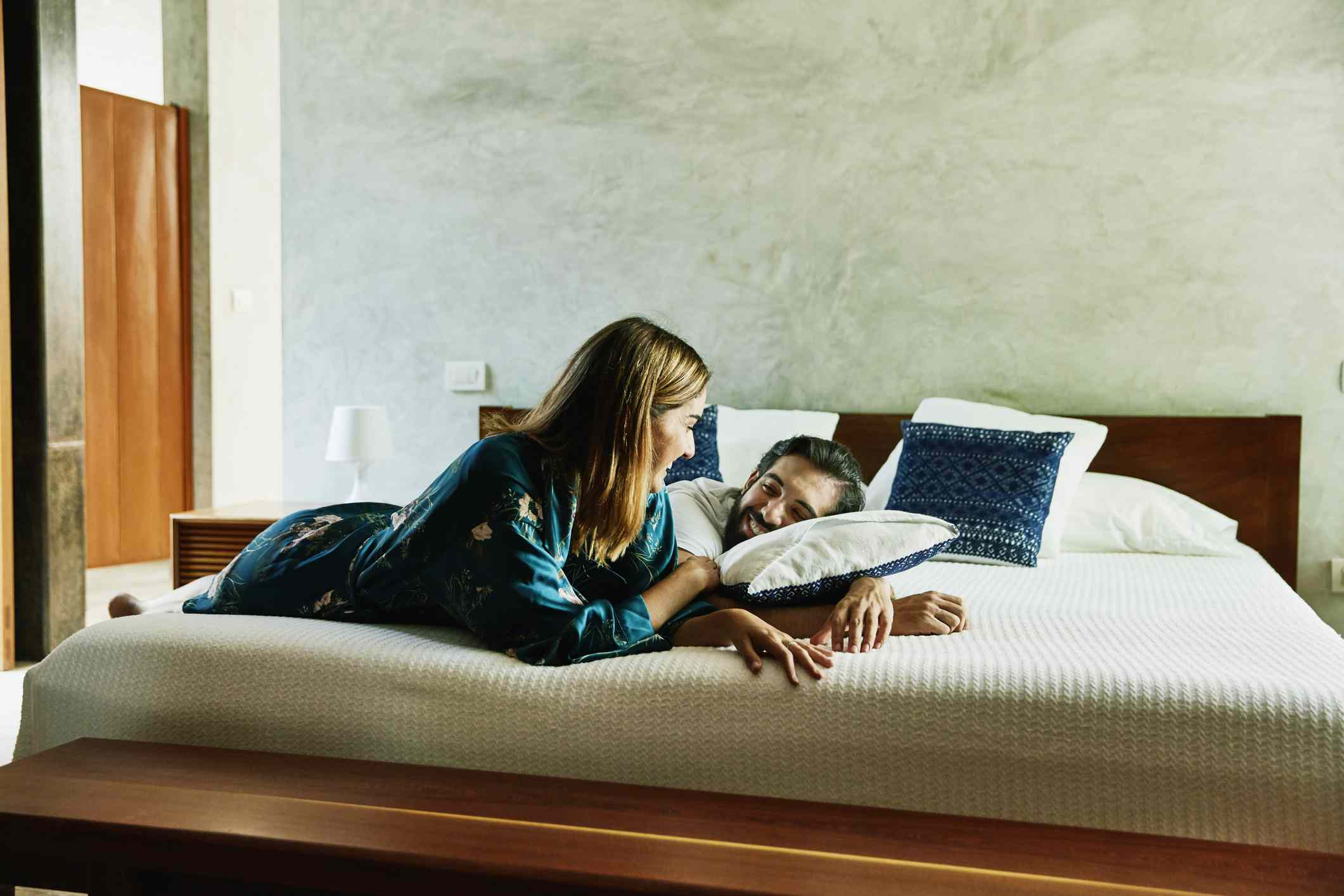 Couple lying on a bed in a luxury hotel