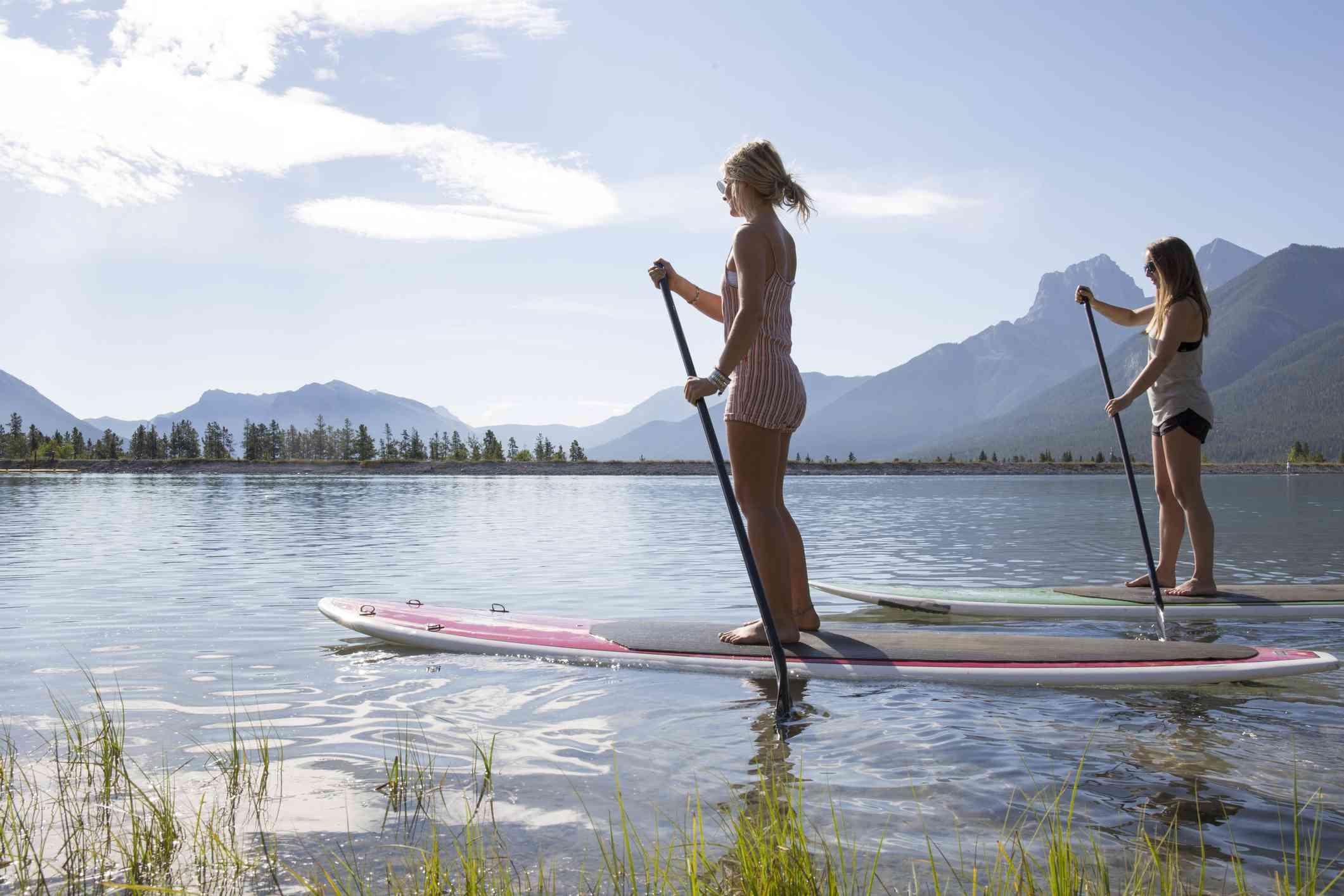 Two women paddle boarding