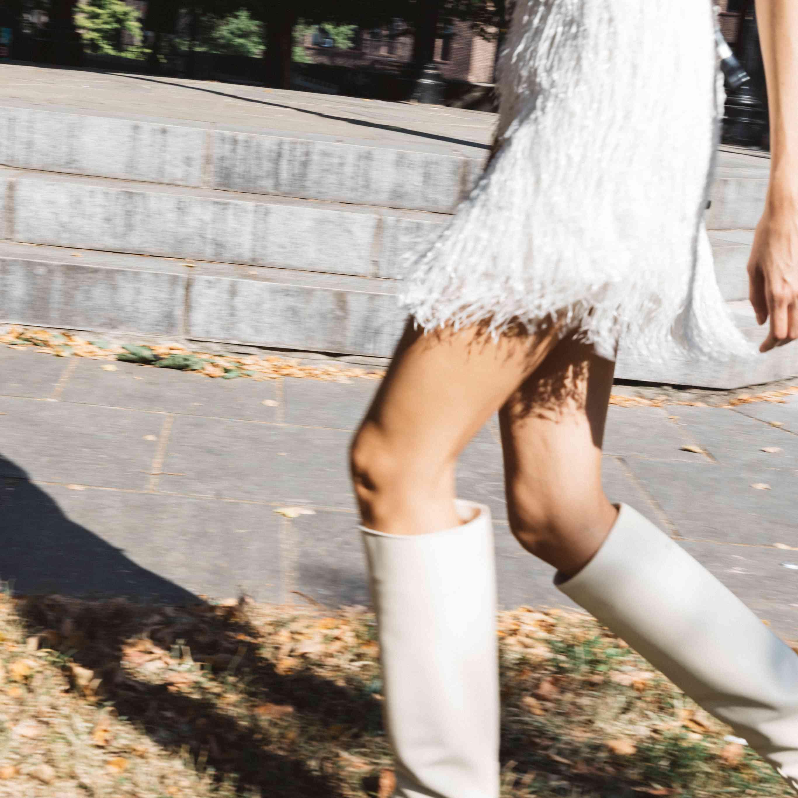 Model in fringe mini wedding dress