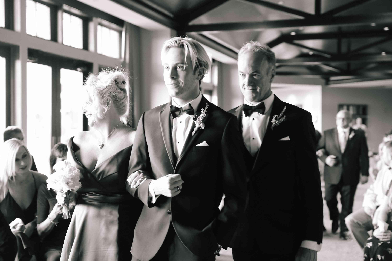 savannah and riker wedding, groom walking down aisle