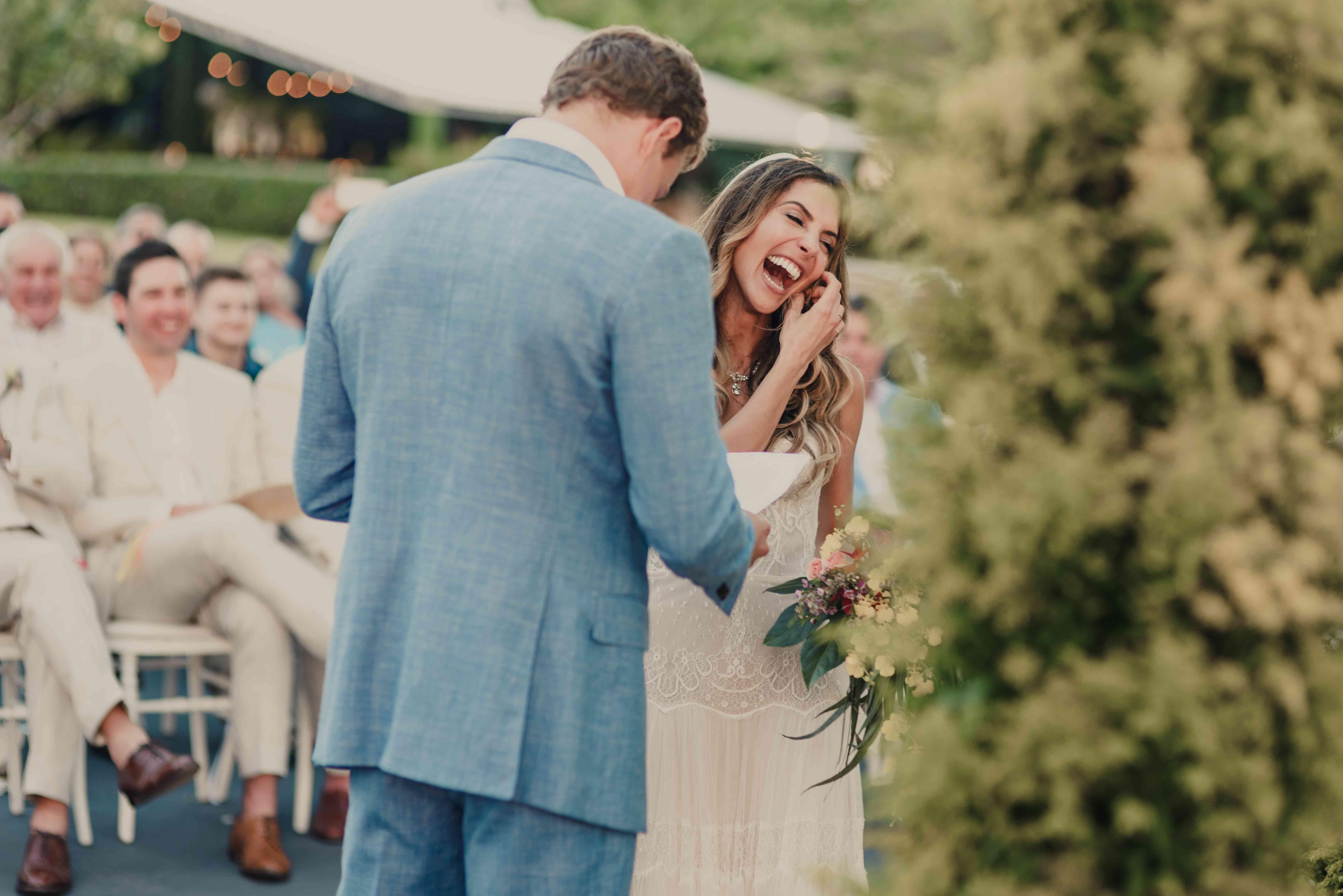 laughing exchanging vows