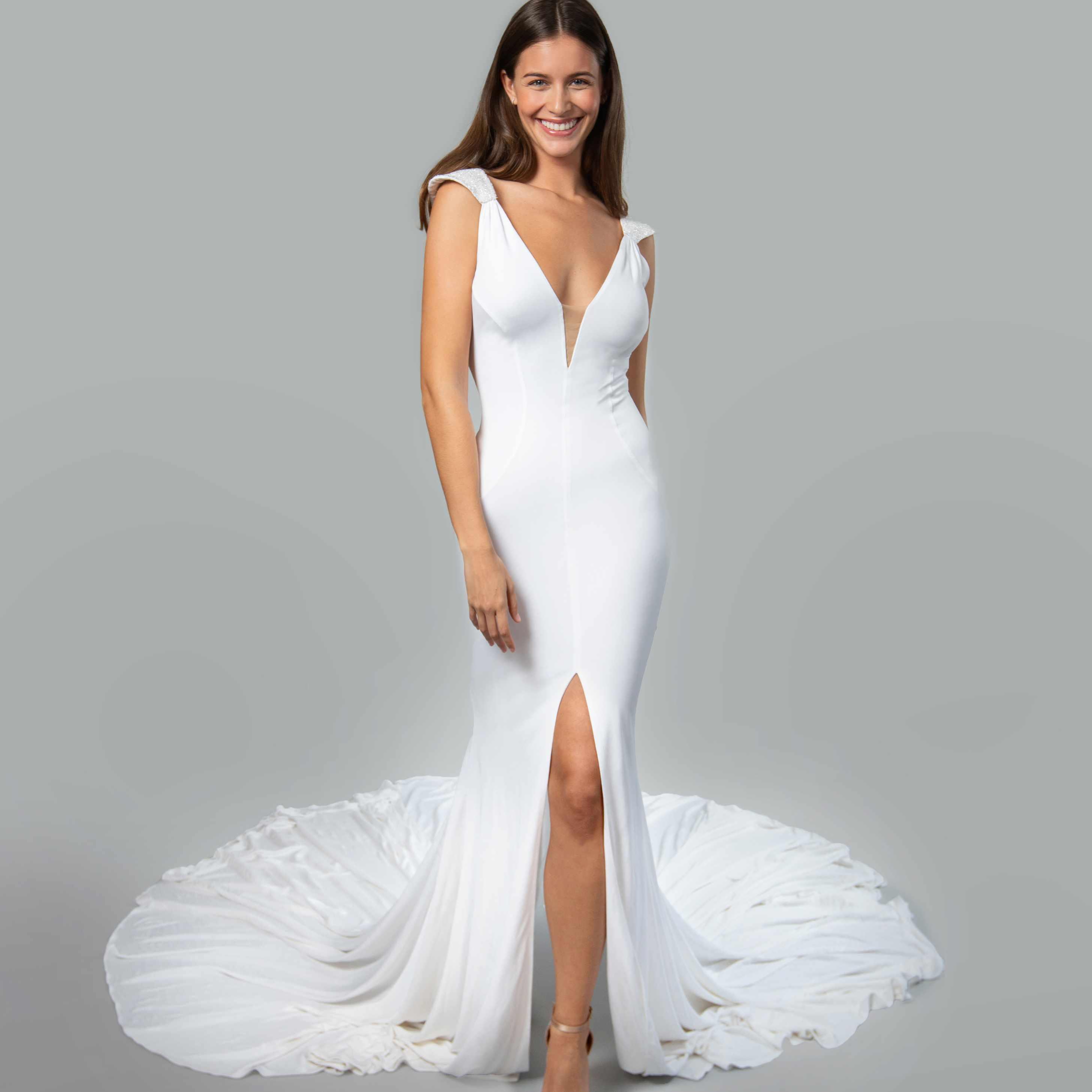 Model in deep V-cut wedding dress