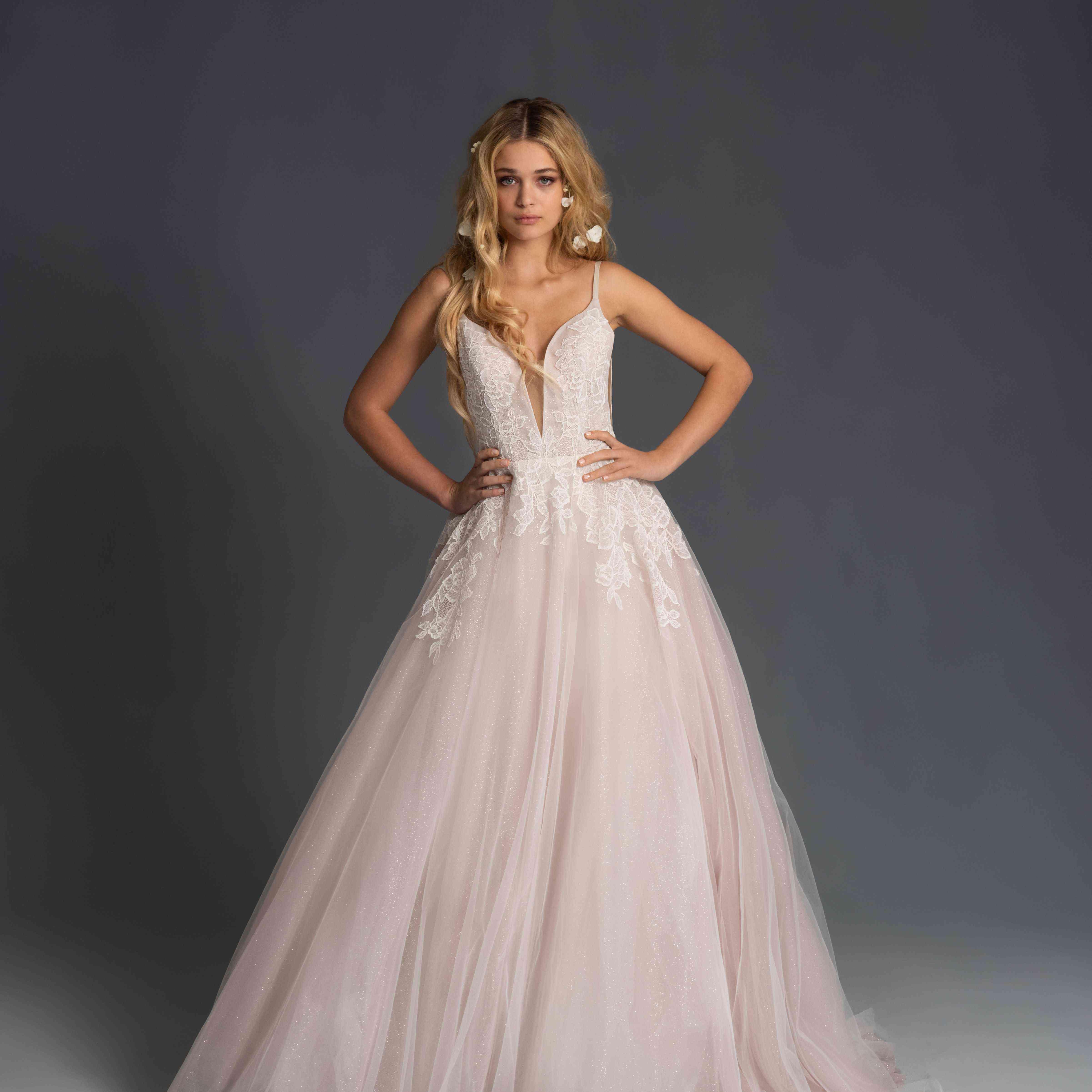 Model in blush sleeveless wedding dress