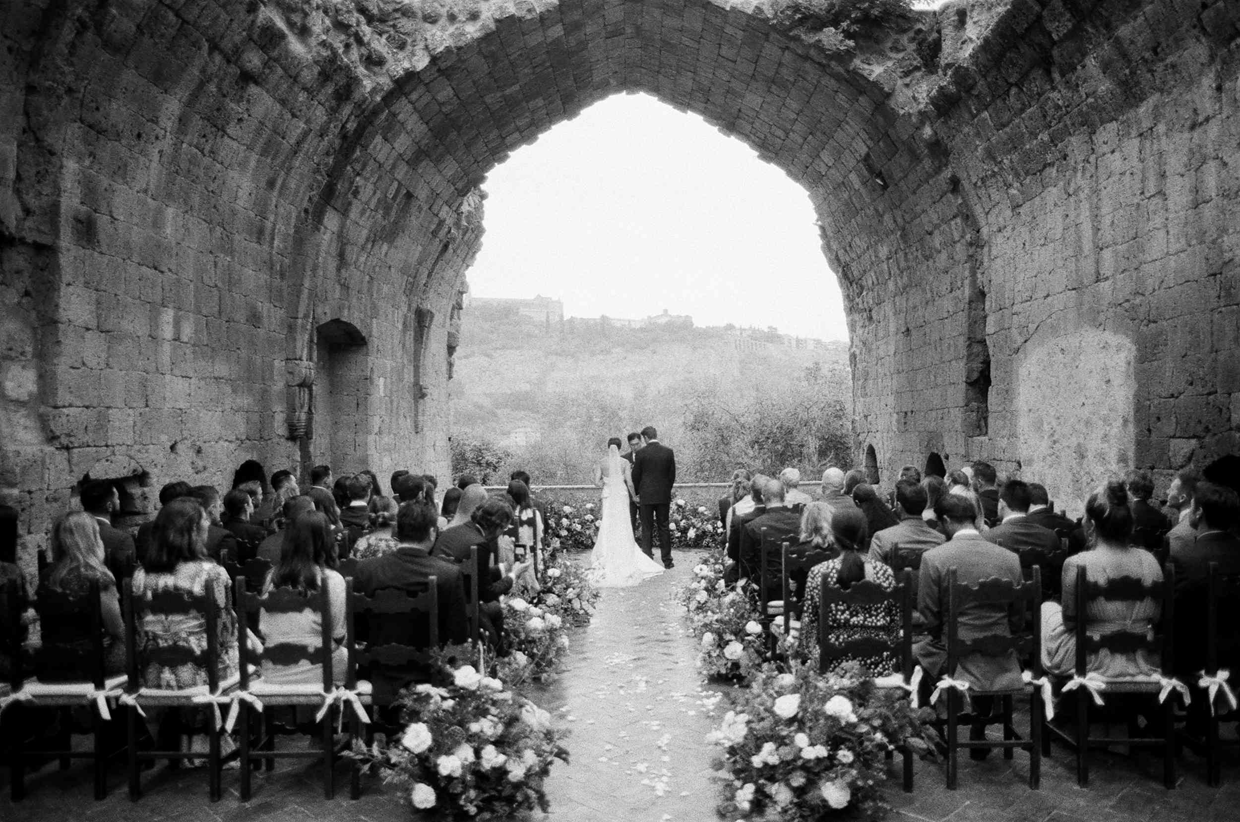 classic la badia italian wedding, bride and groom exchanging vows