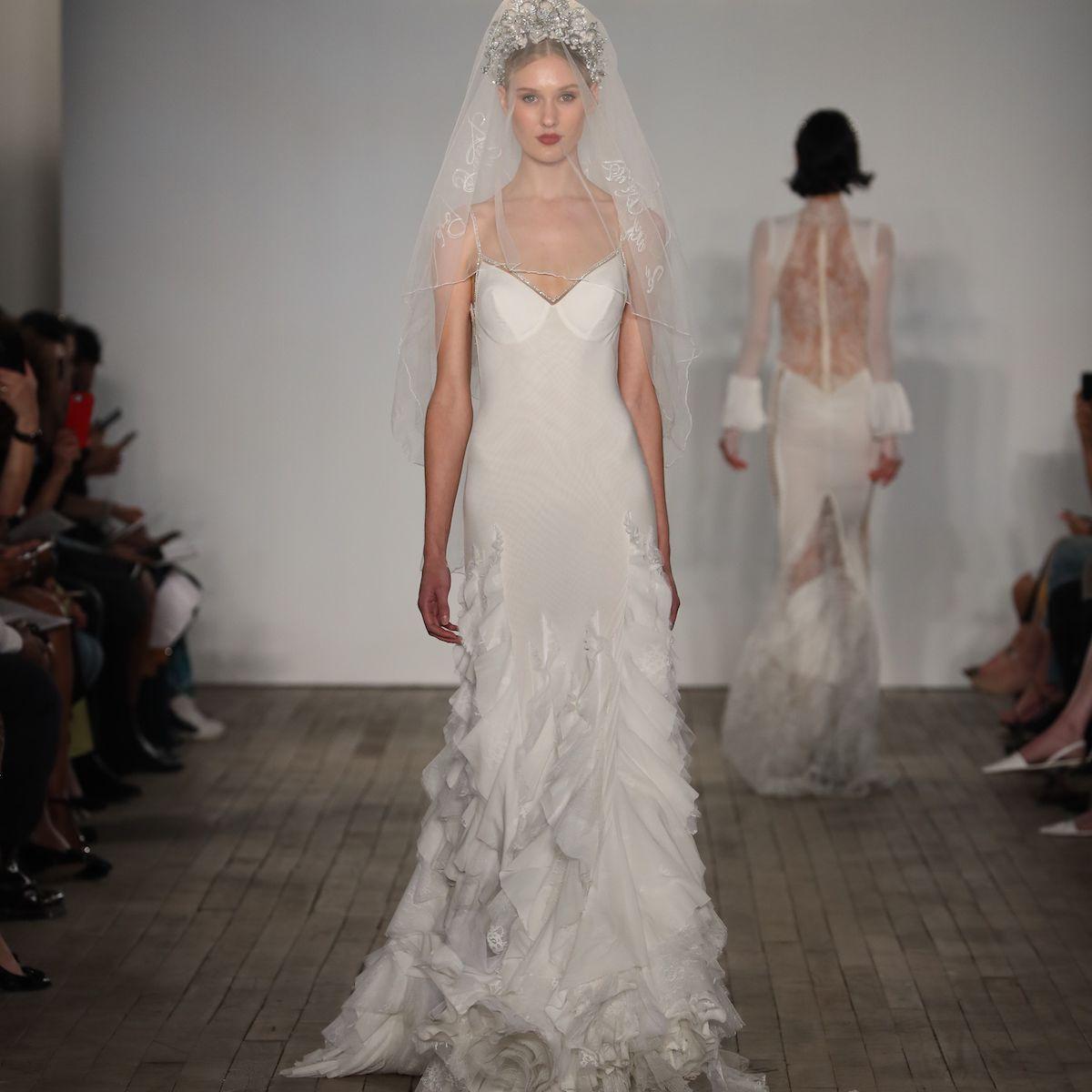 Model in cascading ruffle wedding dress