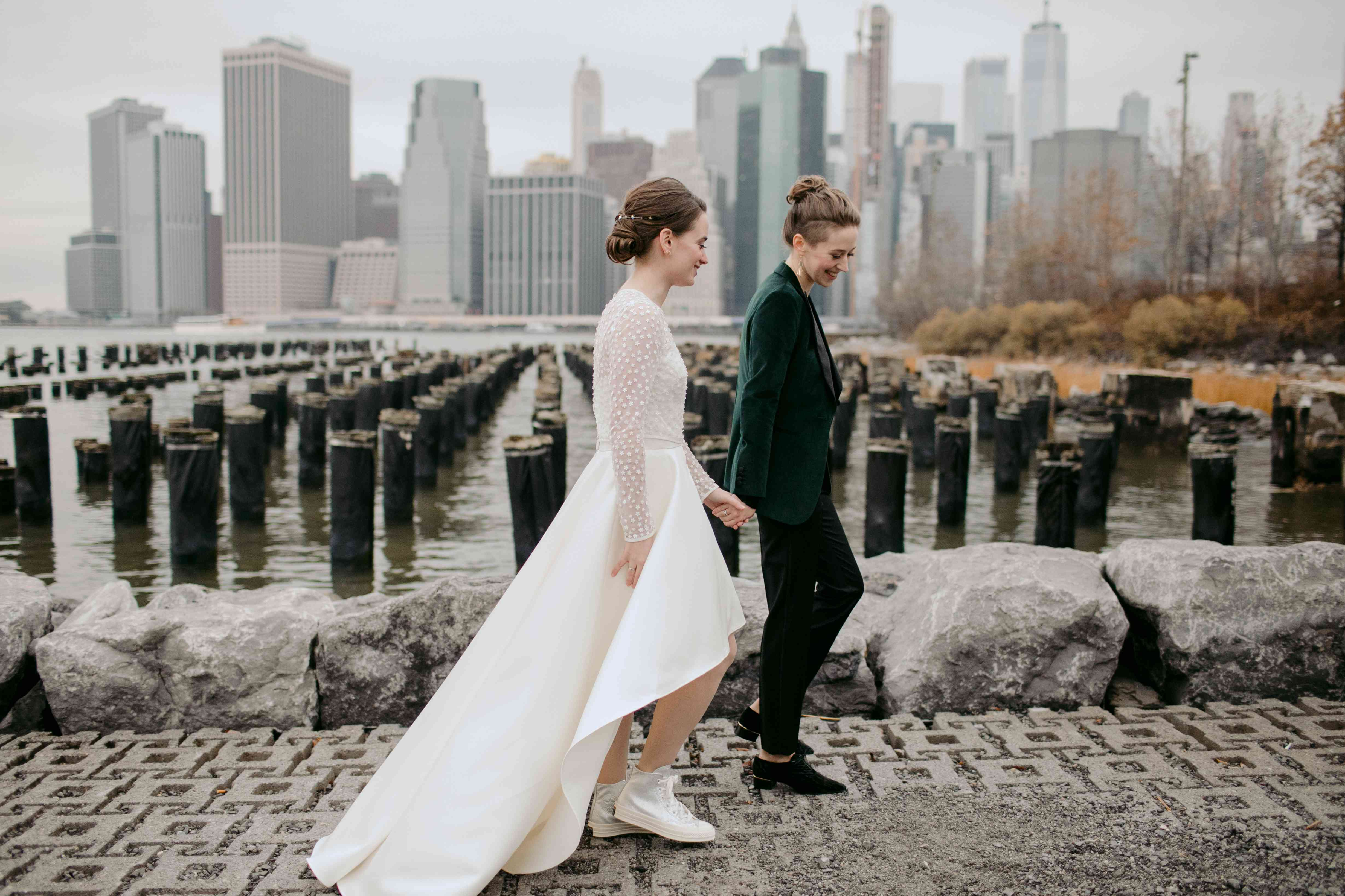 The couple walk along the waterfront