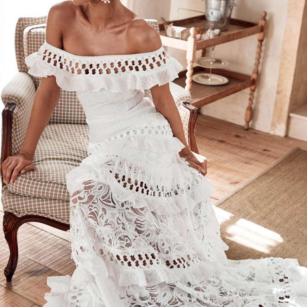 18 Beach Wedding Dresses Perfect for a Seaside Ceremony