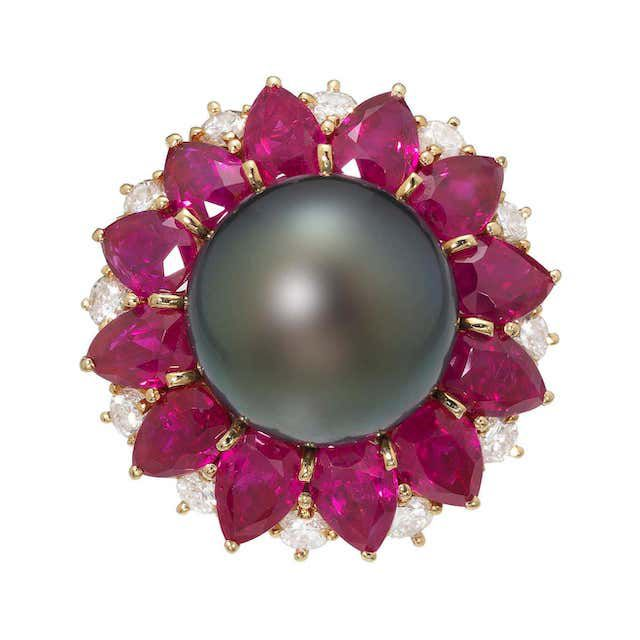 Black pearl ring with ruby and diamond detailing
