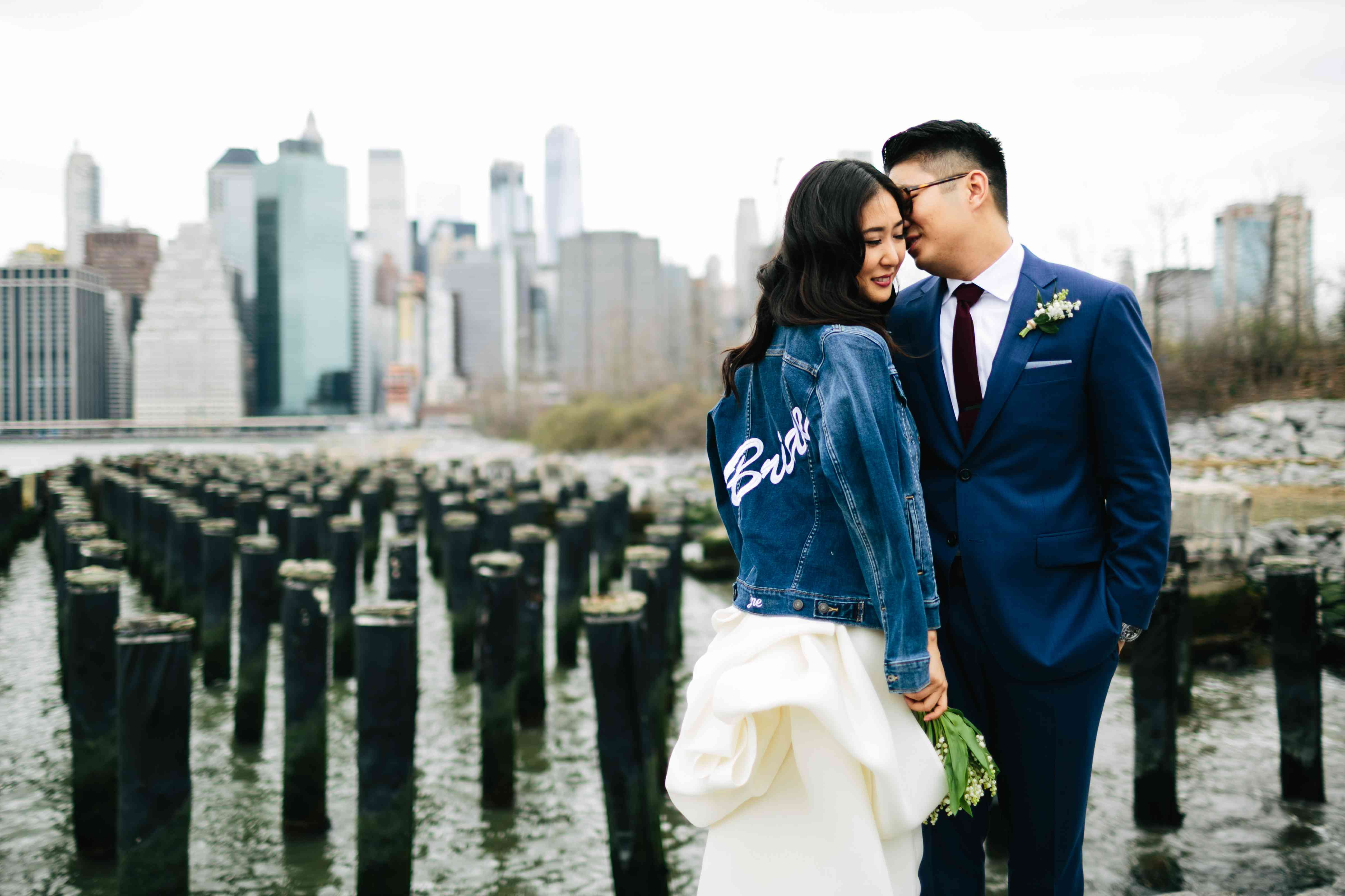 Bride and groom standing on pier