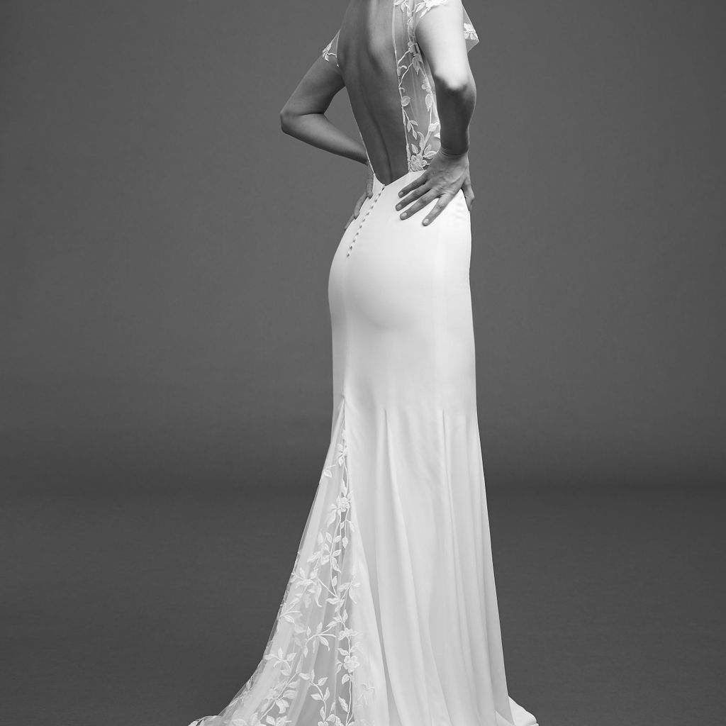 Model in crepe dress with embroidered tulle, cap sleeves, and open back