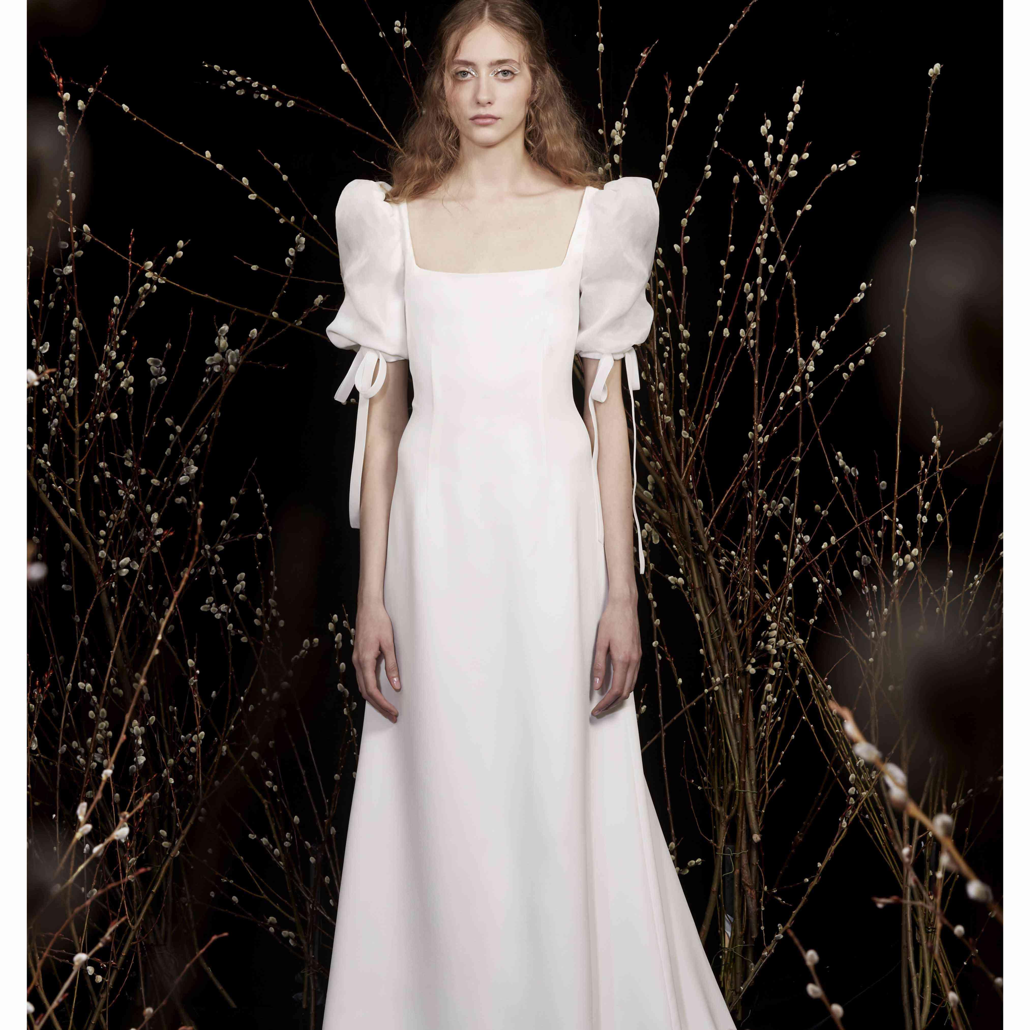 Model in square neckline wedding dress